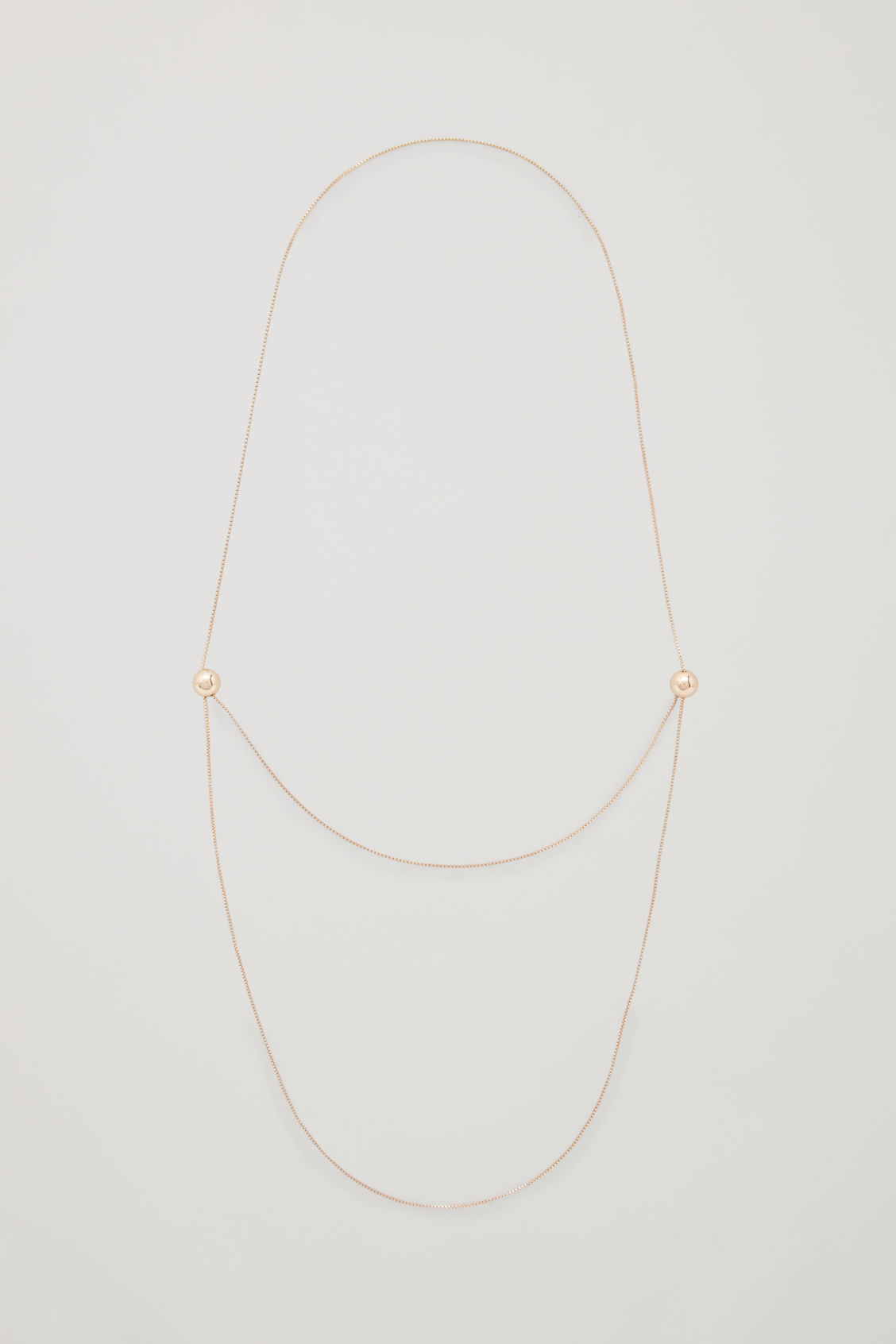 Front image of Cos long adjustable necklace in gold