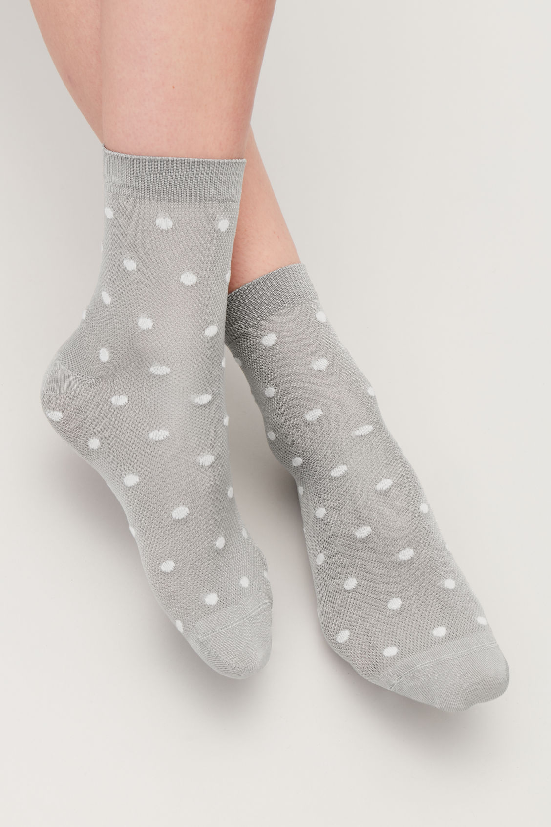 Side image of Cos polka-dot socks in grey