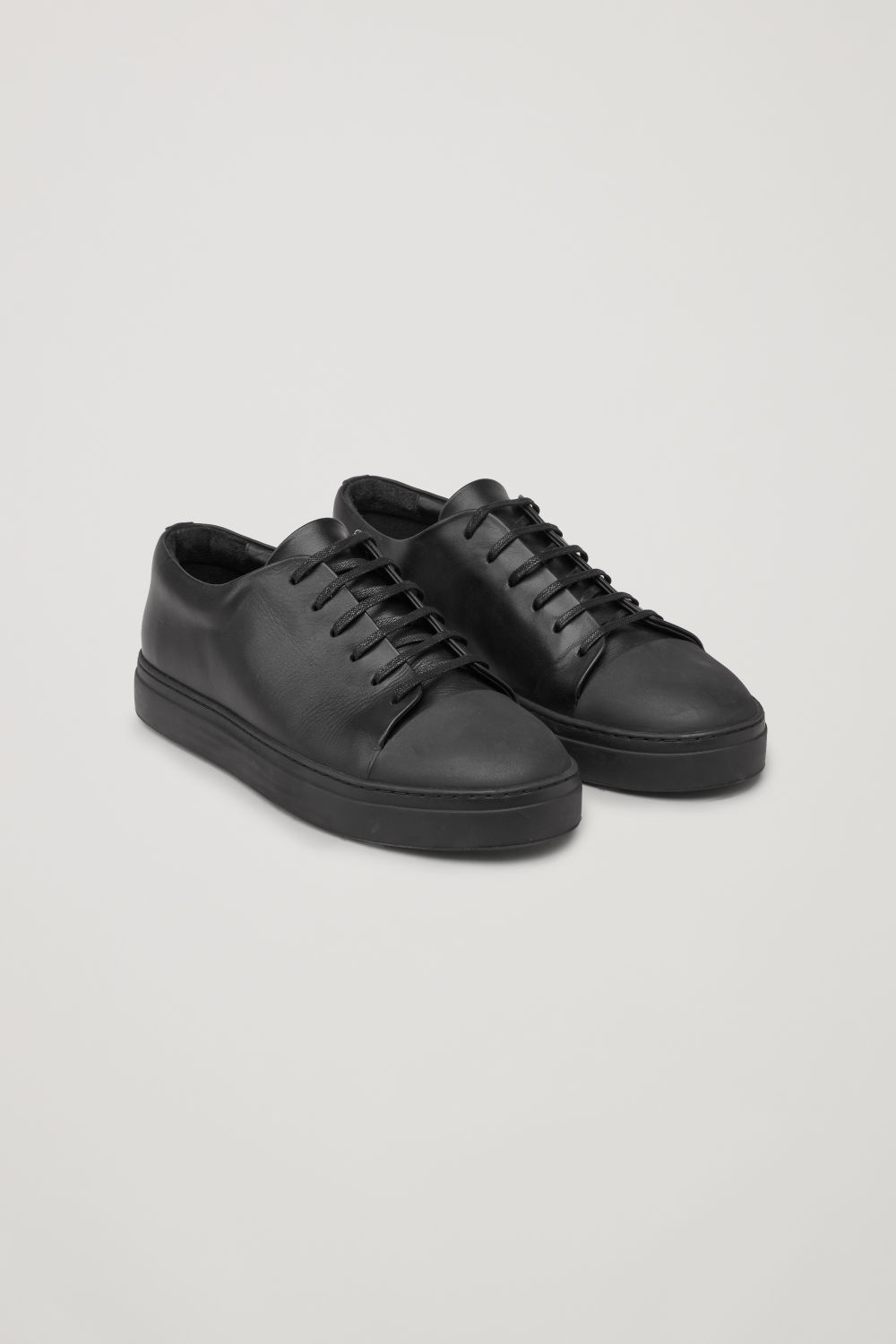 RUBBER-DETAIL LEATHER SNEAKERS