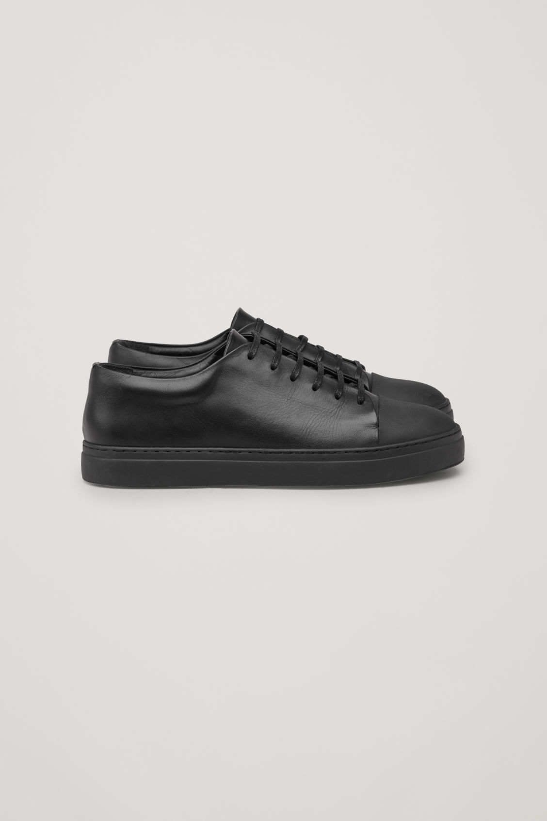 Side image of Cos rubber-detailed leather sneakers  in black