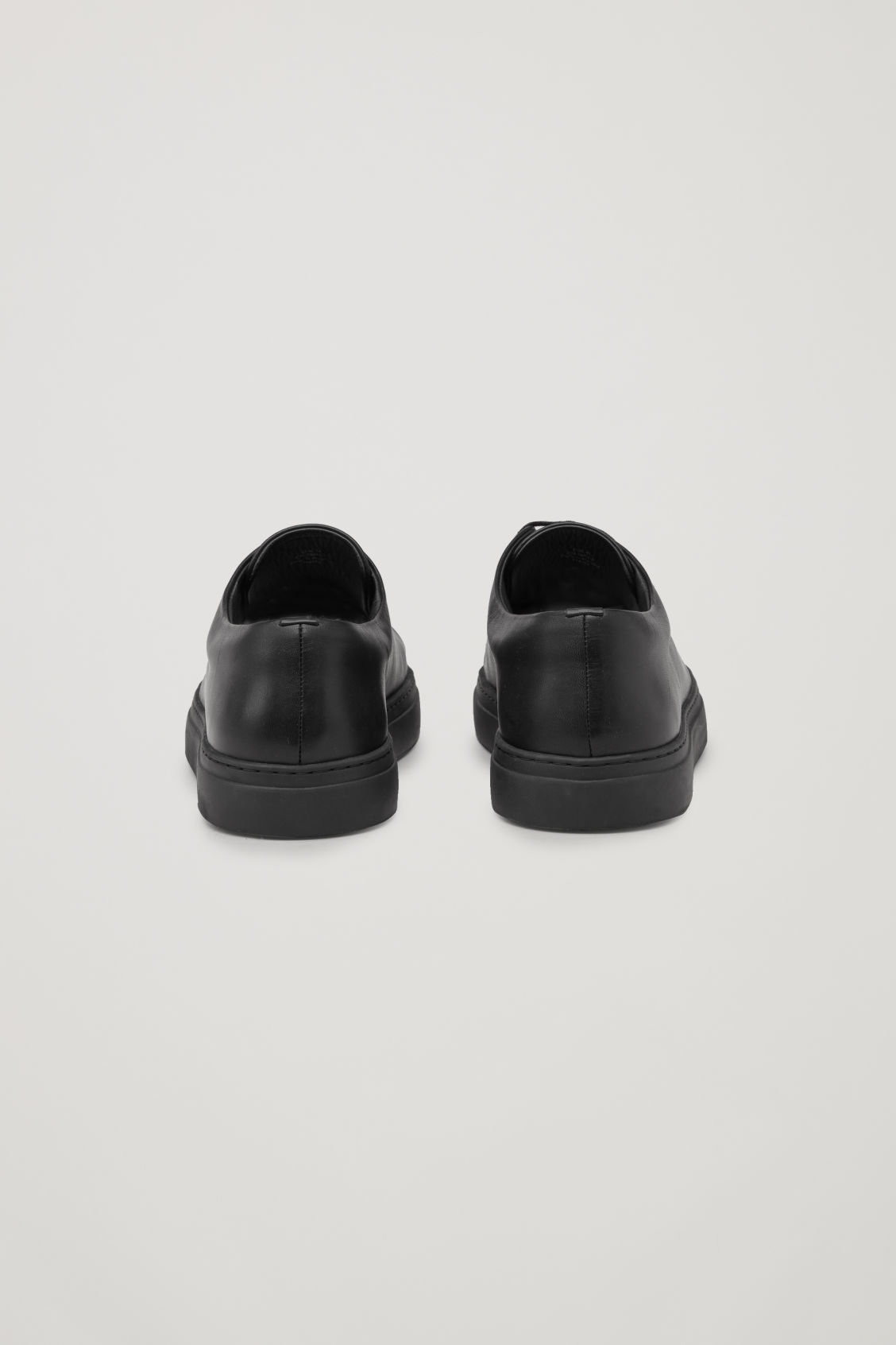 Side image of Cos rubber-detail leather sneakers  in black