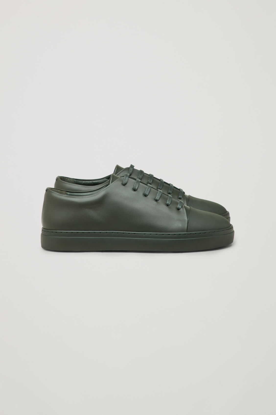 Side image of Cos rubber-detail leather sneakers  in green