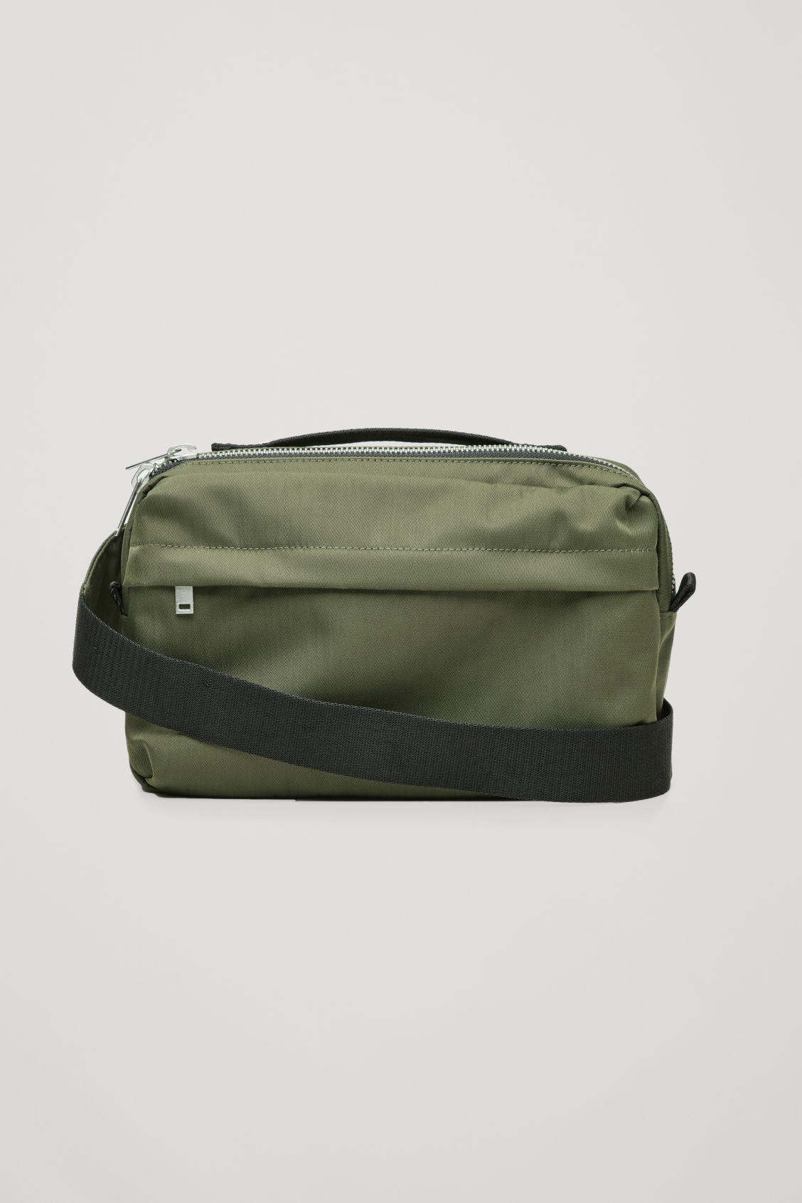 Side image of Cos technical belt bag in green