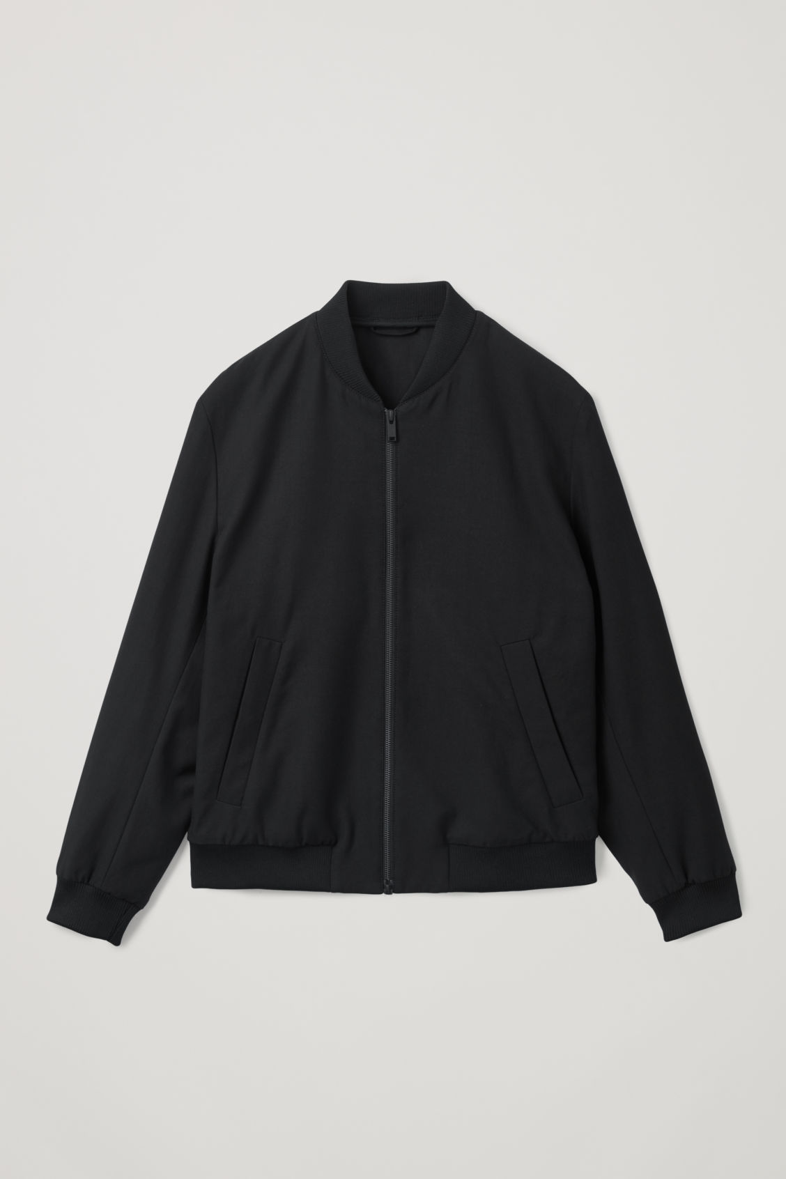 Front image of Cos cotton bomber jacket in black