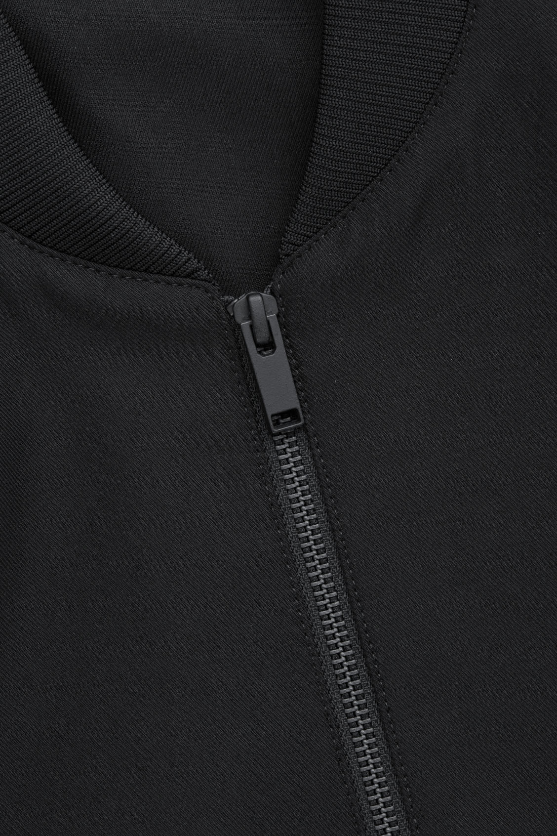 Side image of Cos cotton bomber jacket in black