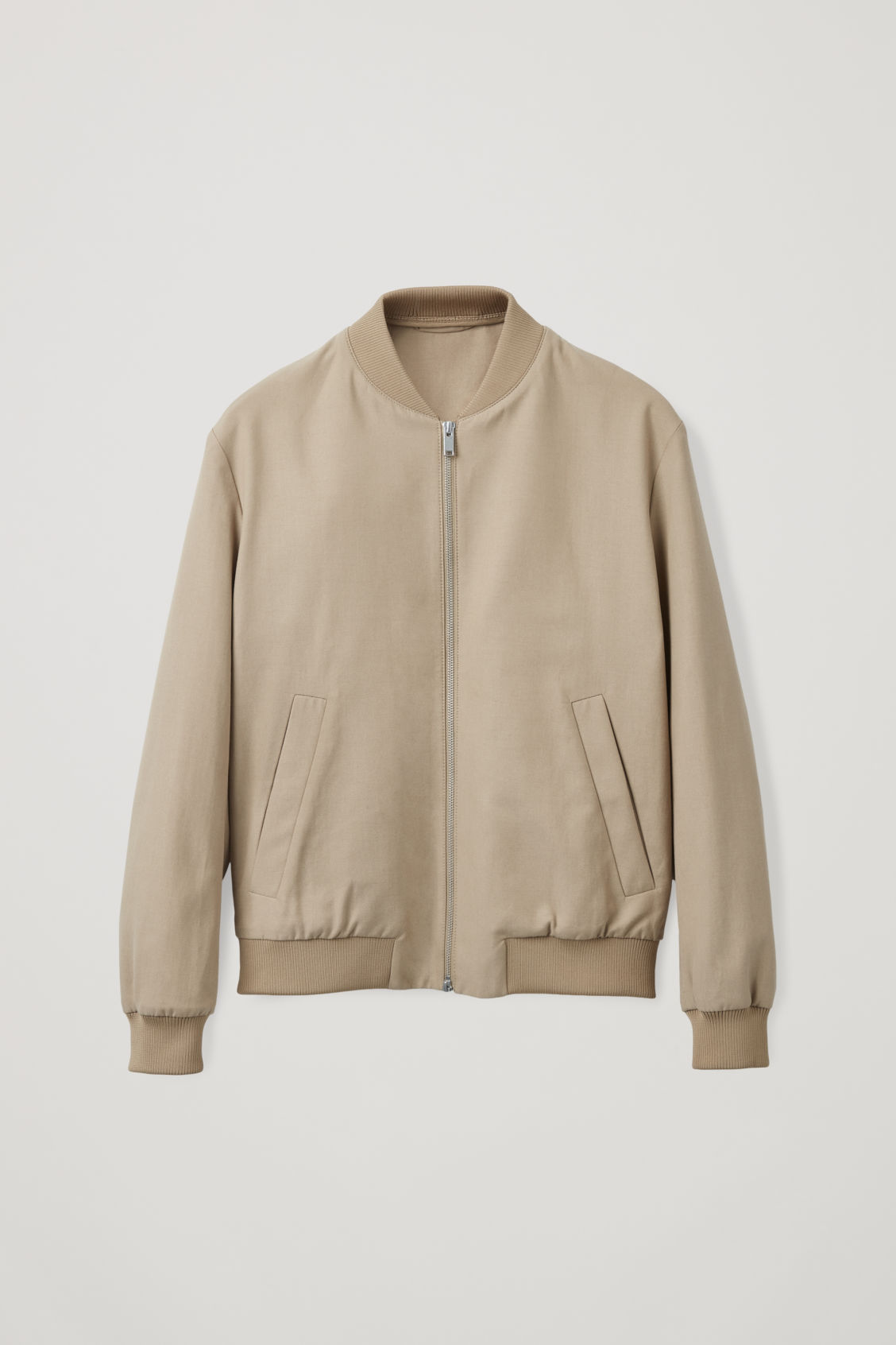 Front image of Cos cotton bomber jacket in beige