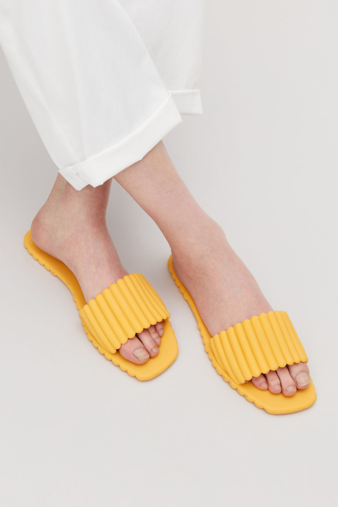 Side image of Cos scalloped rubber sliders in yellow