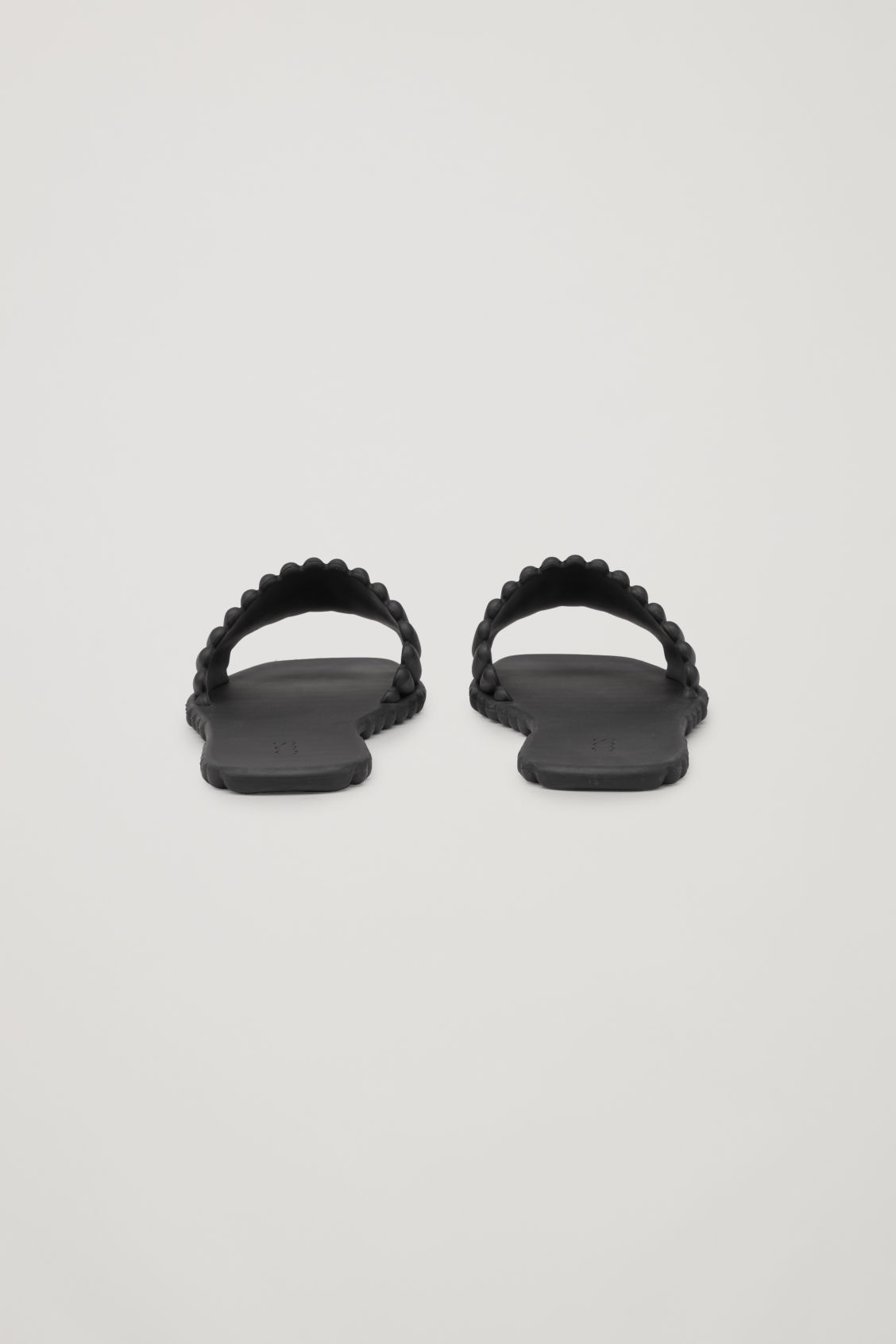 Side image of Cos scalloped rubber slides in black