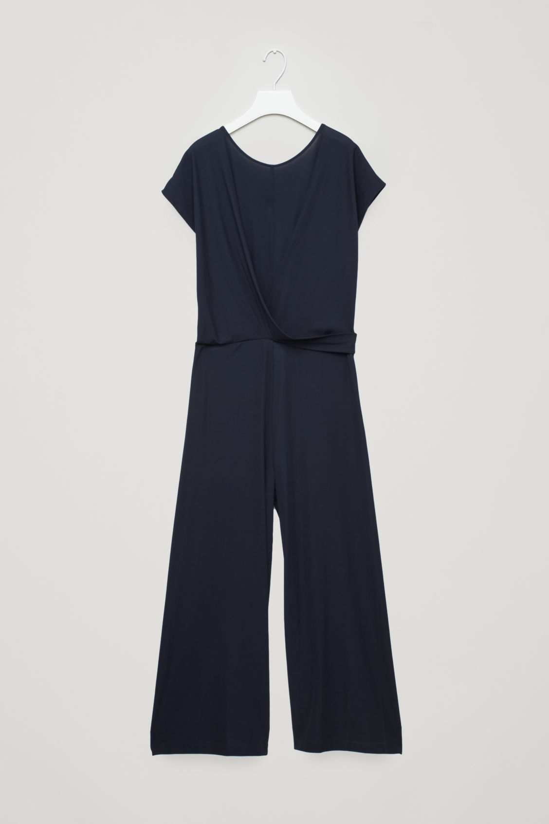 f602b362498 Front image of Cos wrap-front jersey jumpsuit in blue