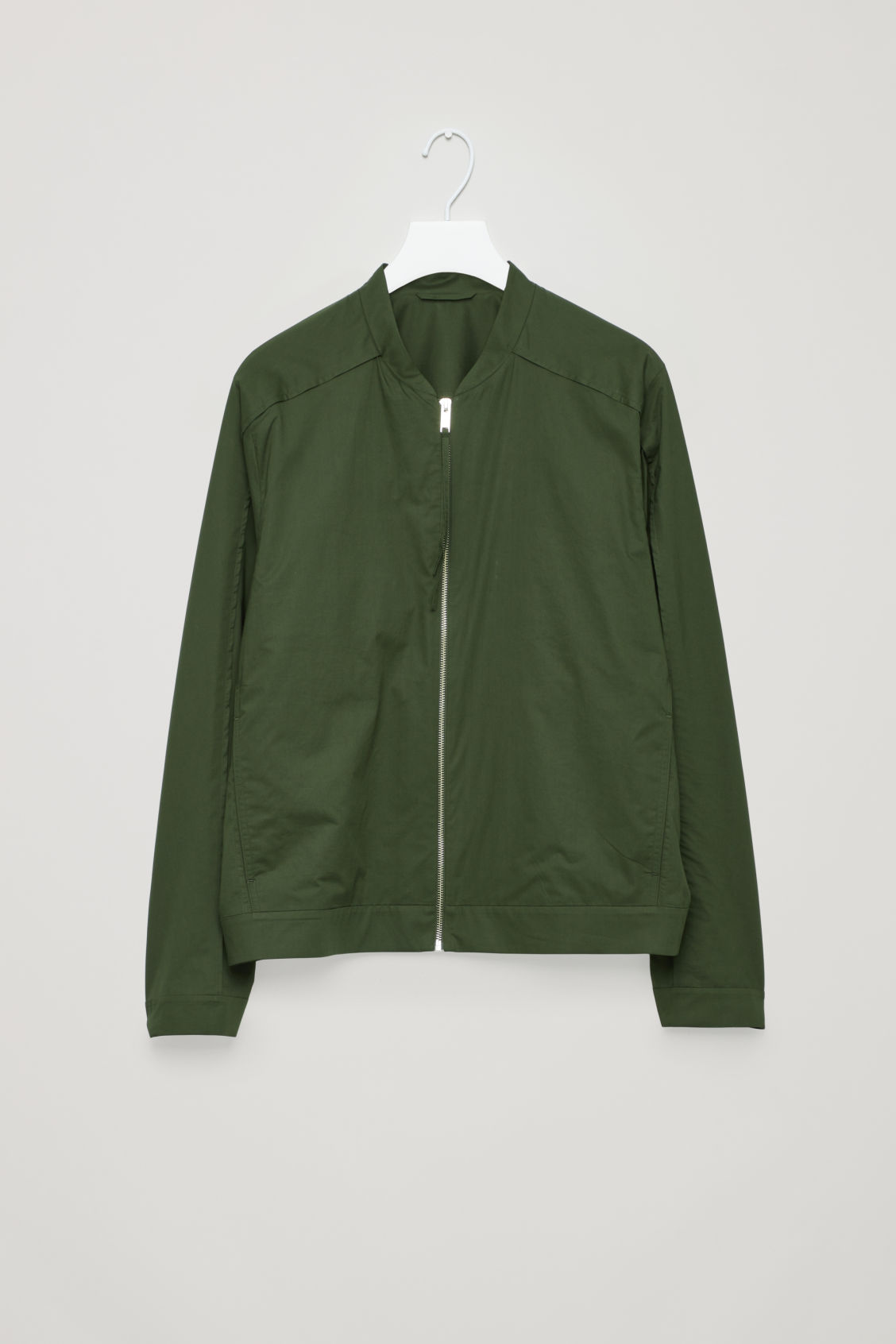 Front image of Cos seam-detailed bomber jacket in green