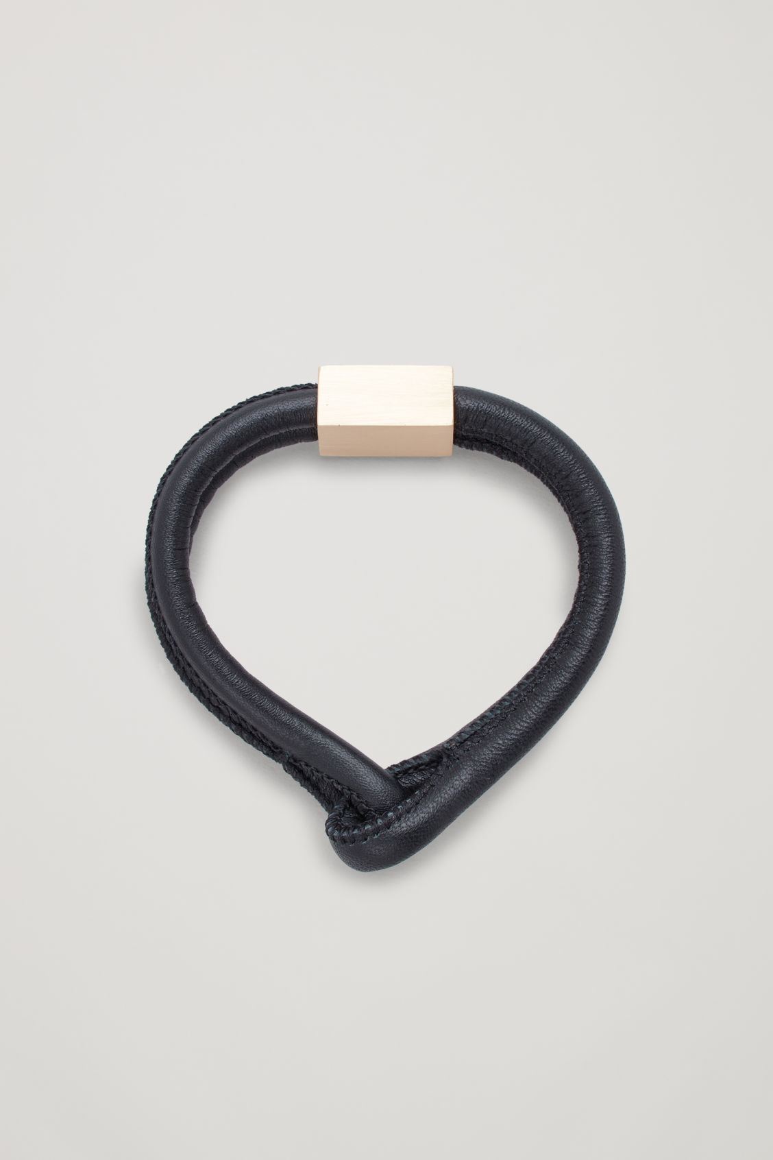 Front image of Cos leather knotted bracelet   in black