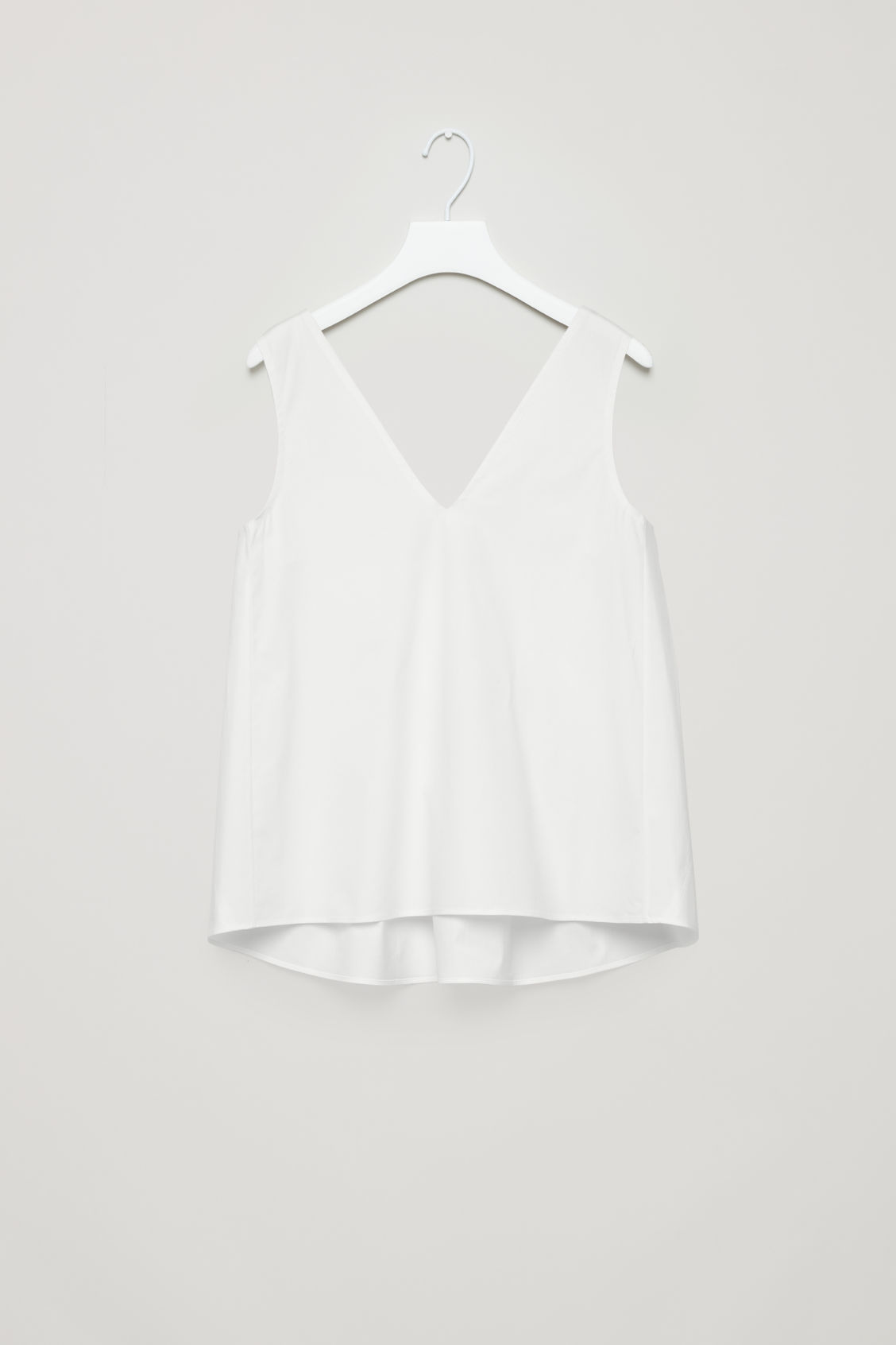 Front image of Cos low v-neck pleated top in white