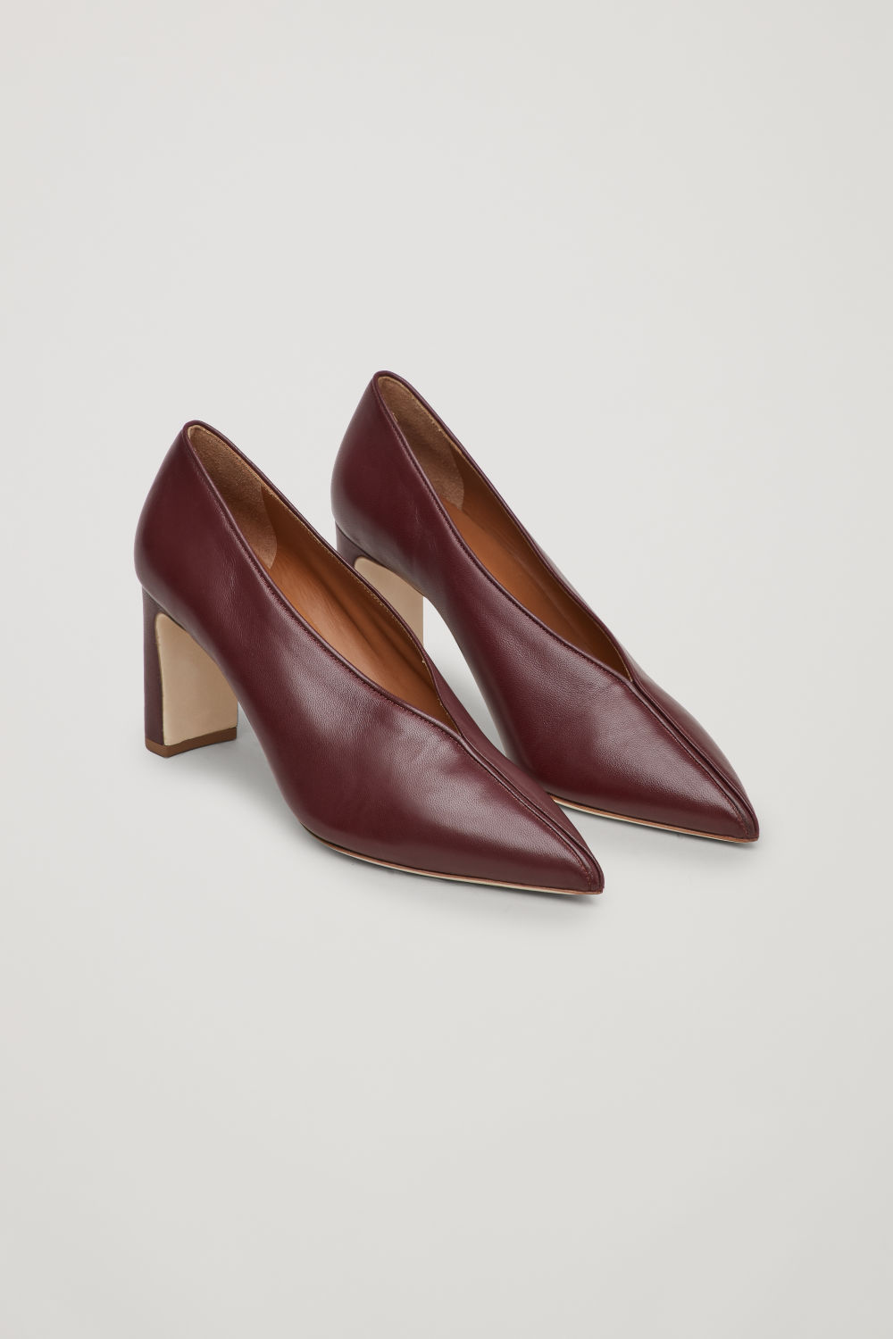 Front image of Cos piping-trimmed leather heels in burgundy