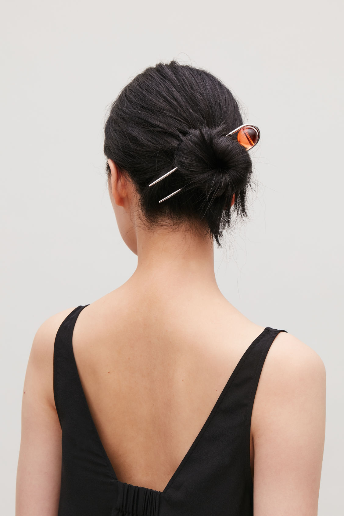 Side image of Cos glass-ball hairpin in orange