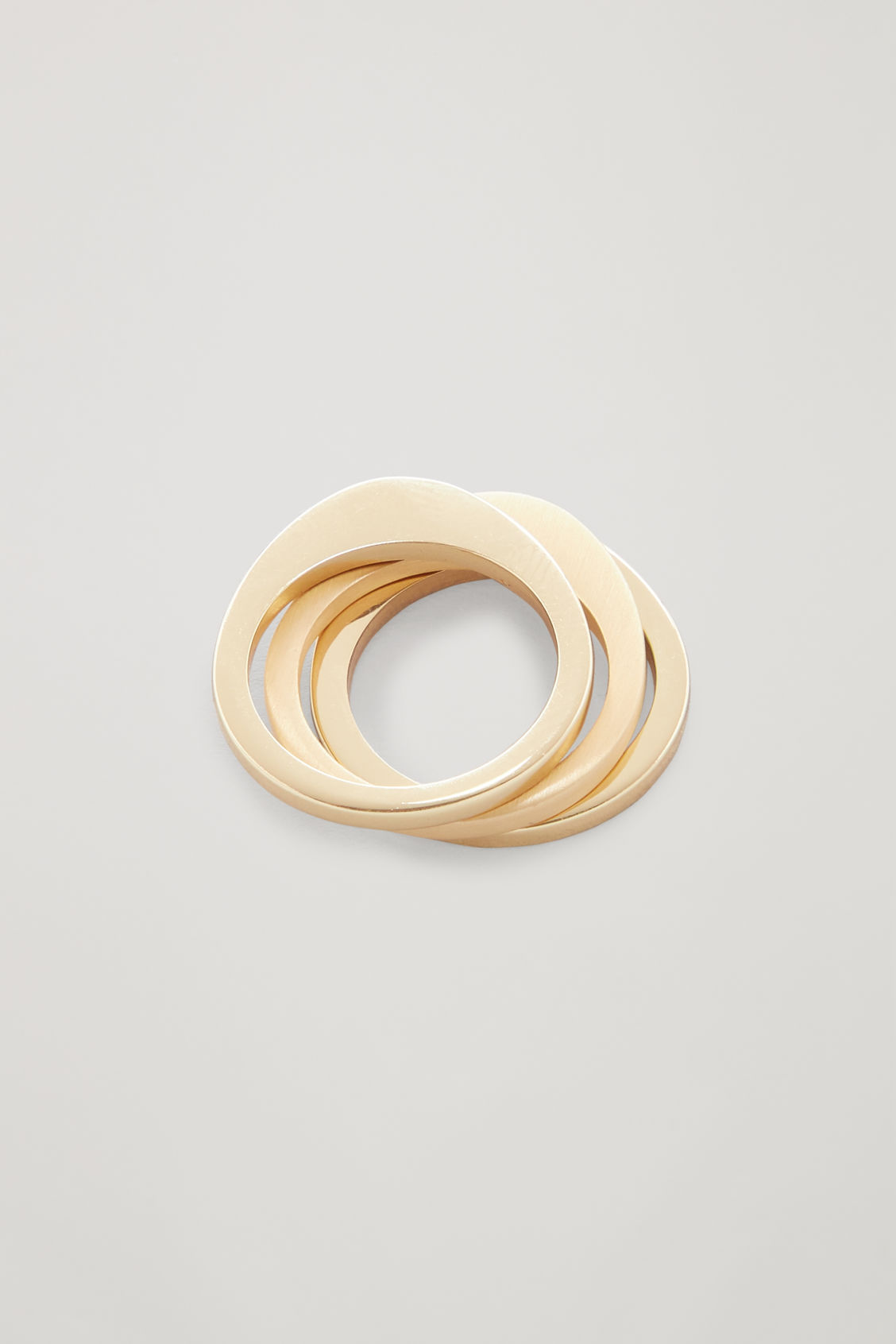 Side image of Cos set of 3 stacking rings in gold