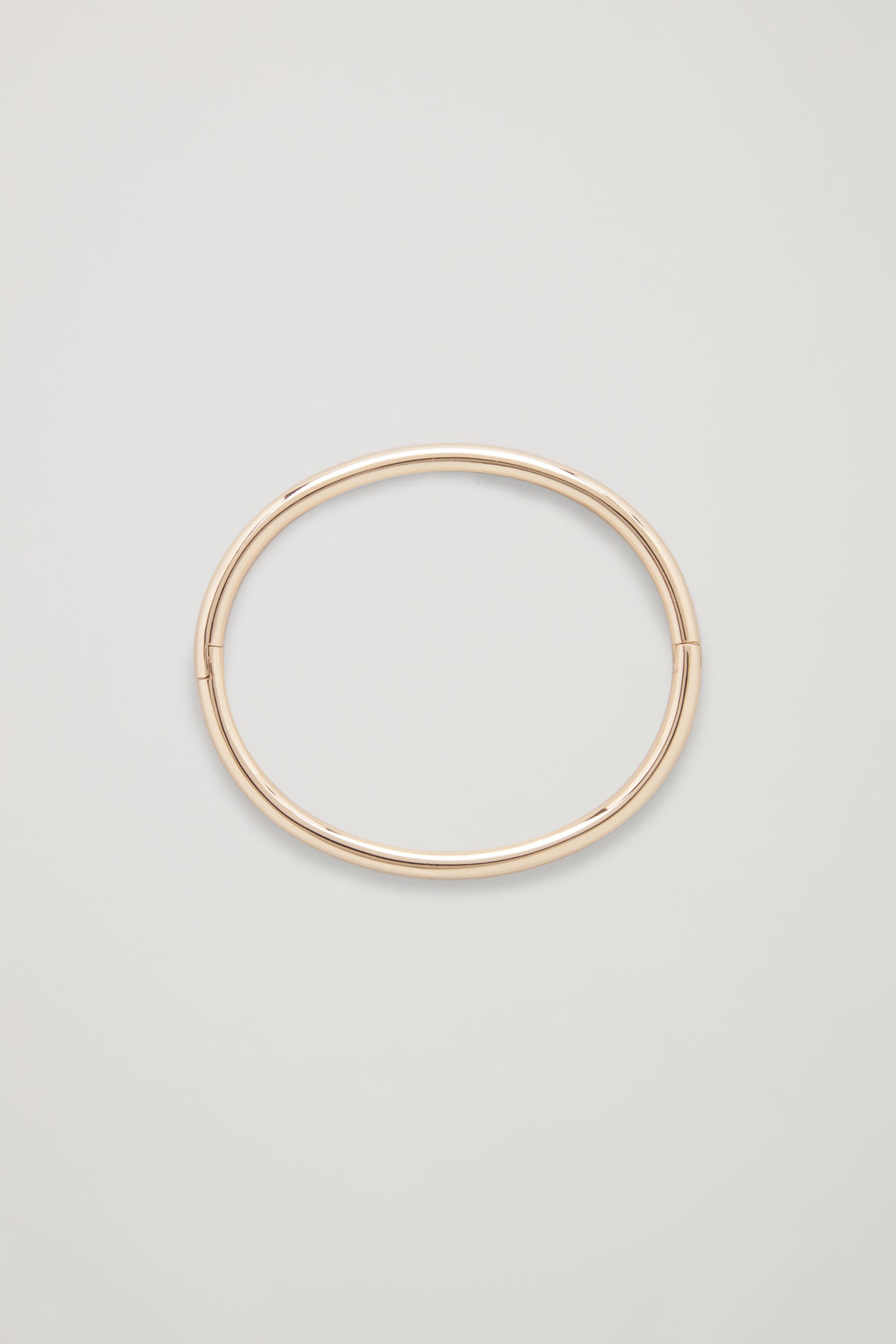 Front image of Cos circle-cut metal bangle in gold