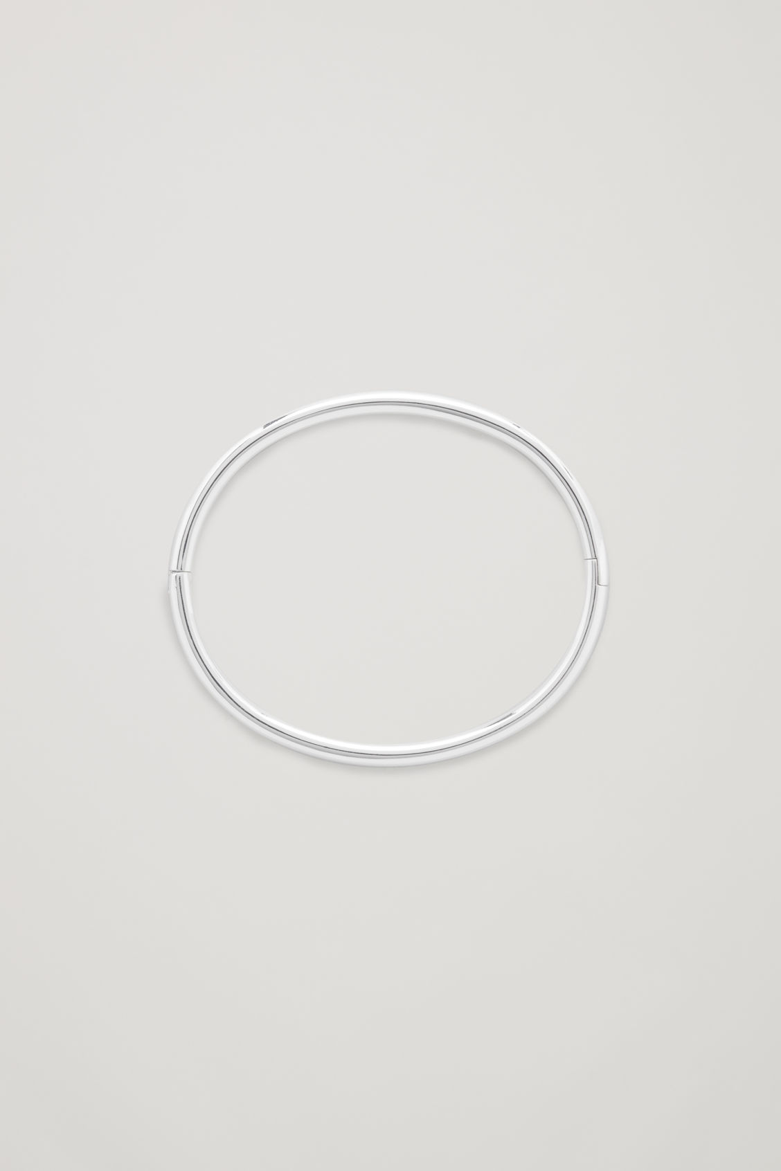 Front image of Cos circle-cut metal bangle in silver