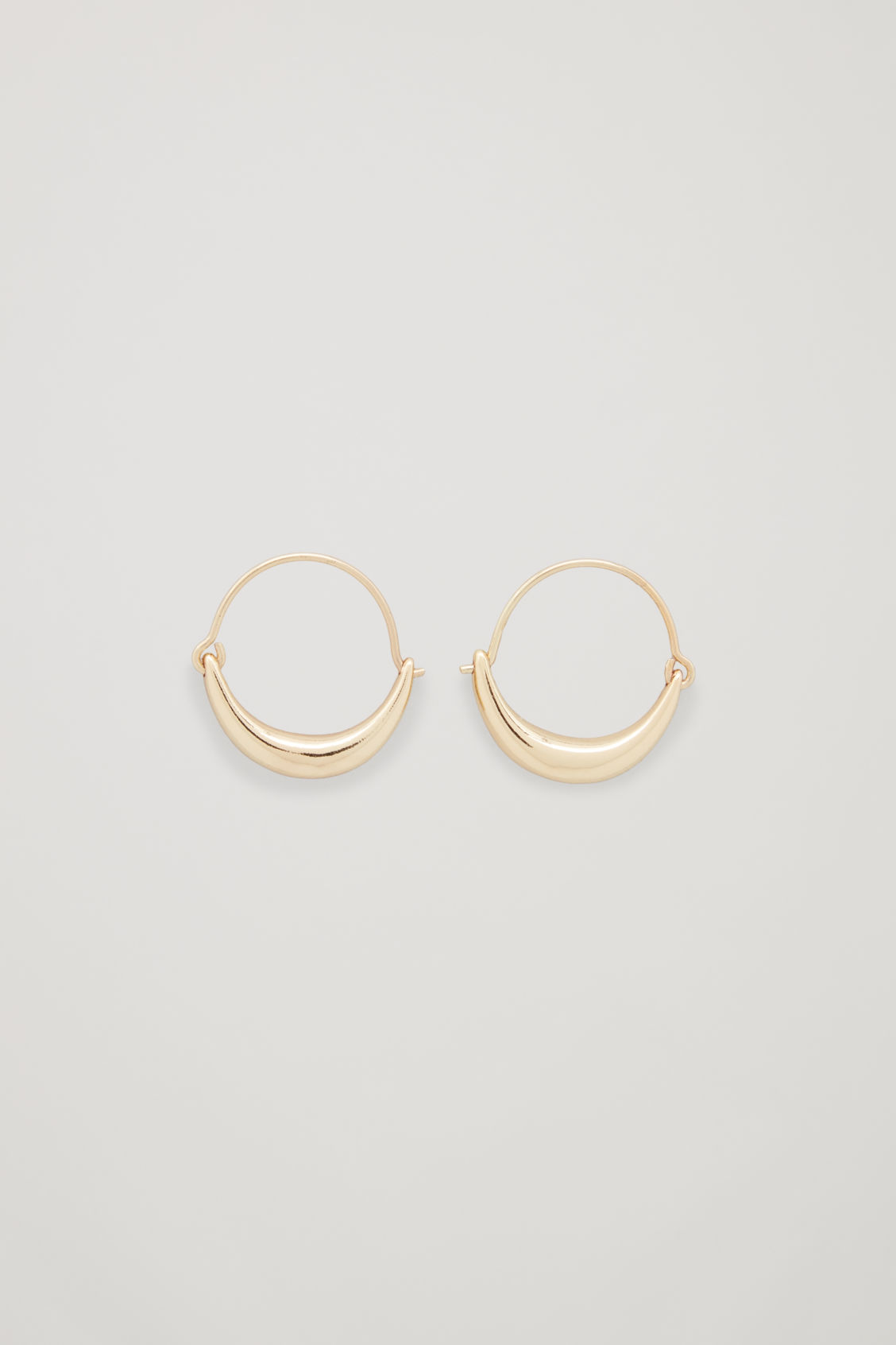Front image of Cos abstract hoop earrings in gold