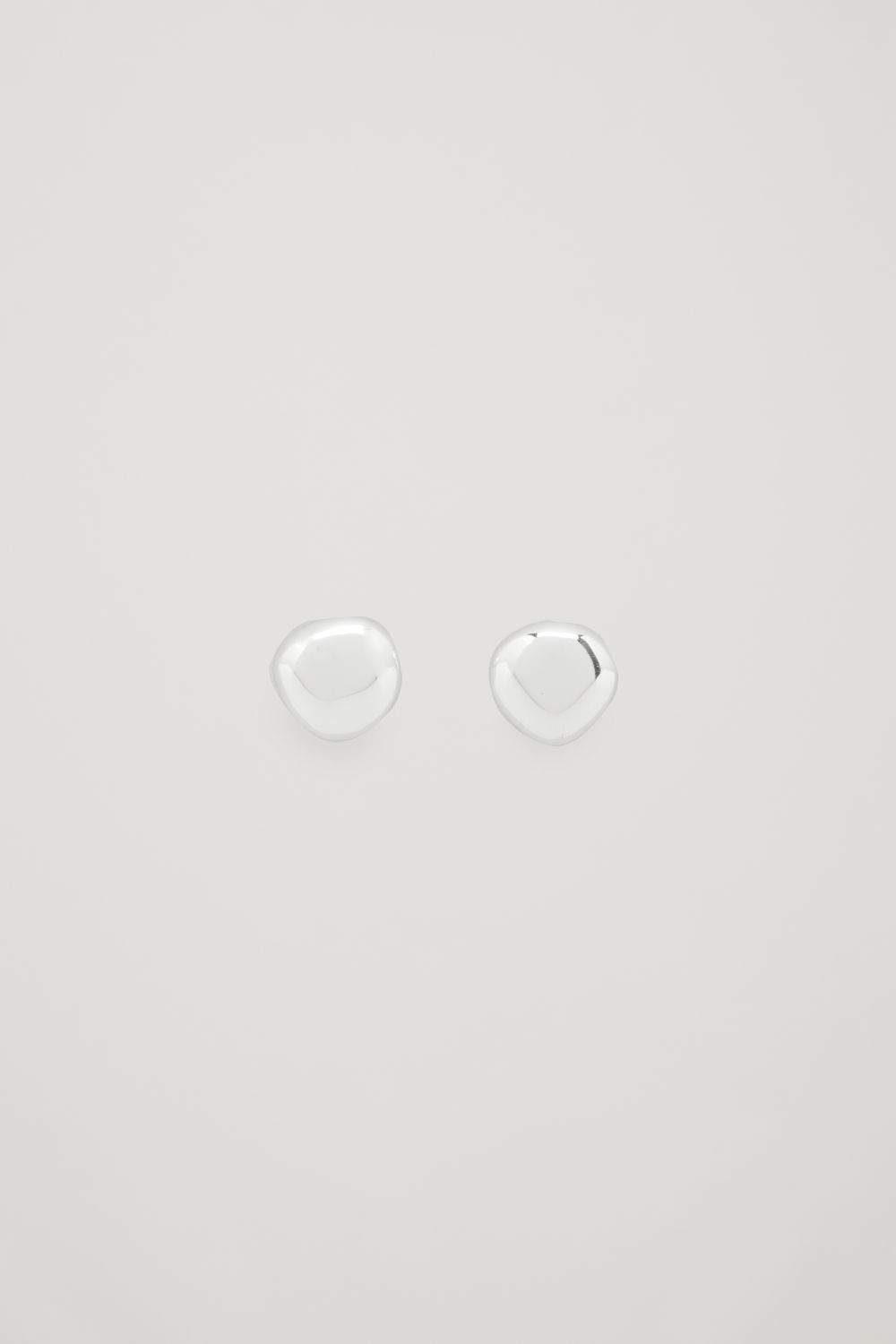 Front image of Cos abstract stud earrings in silver