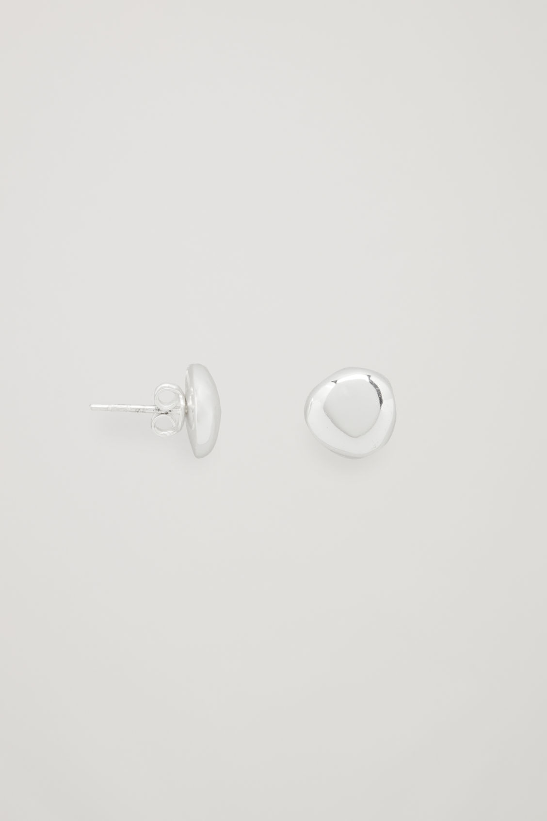 Side image of Cos abstract stud earrings in silver