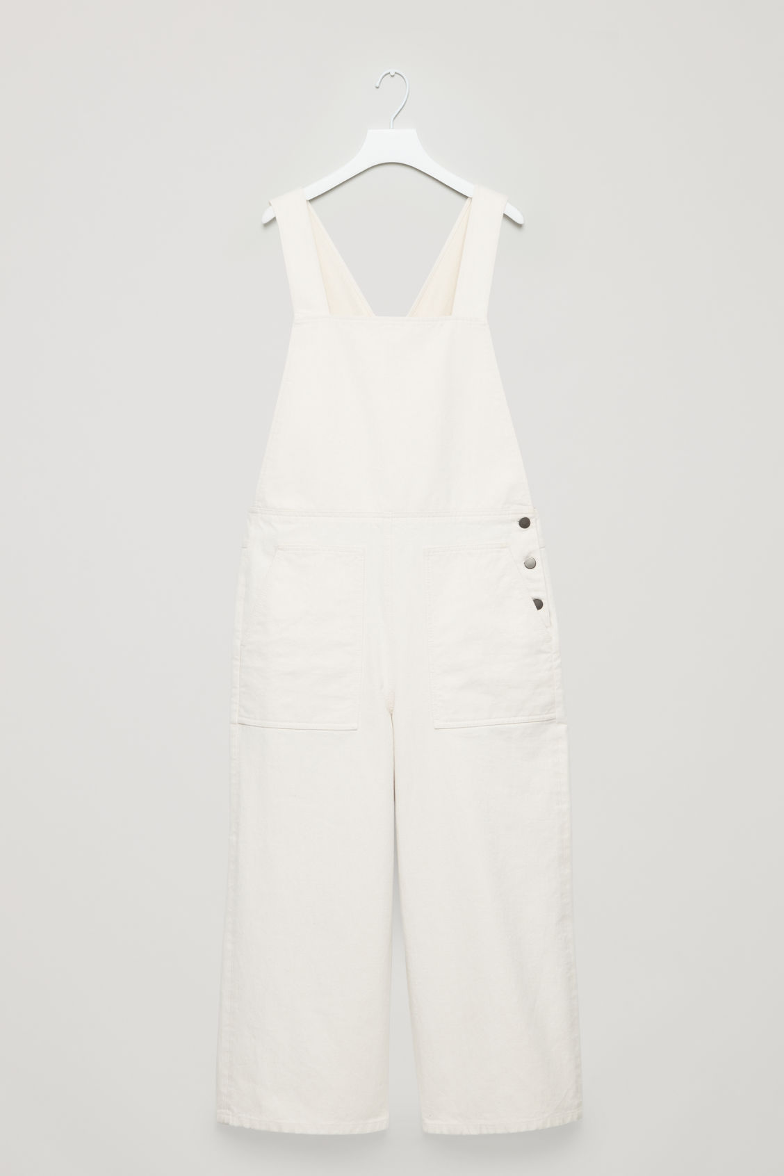Front image of Cos denim dungarees in white