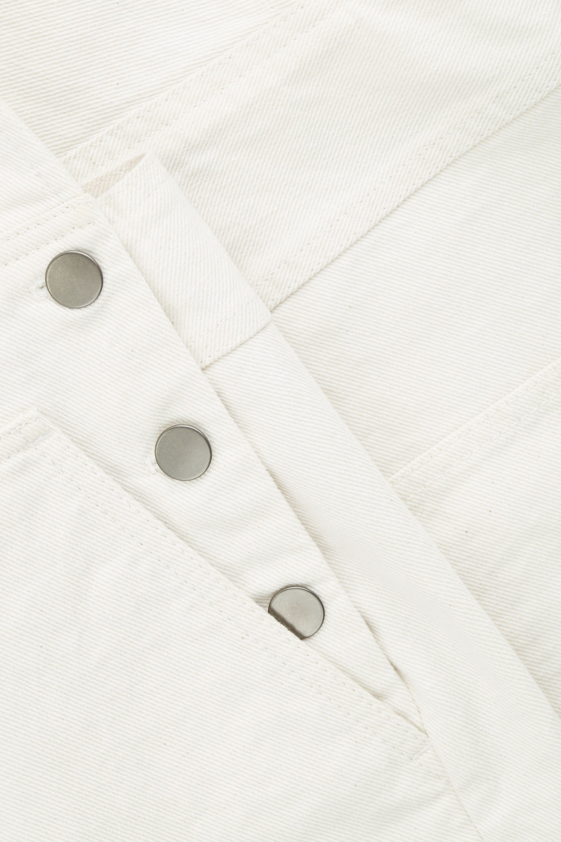 Side image of Cos denim dungarees in white