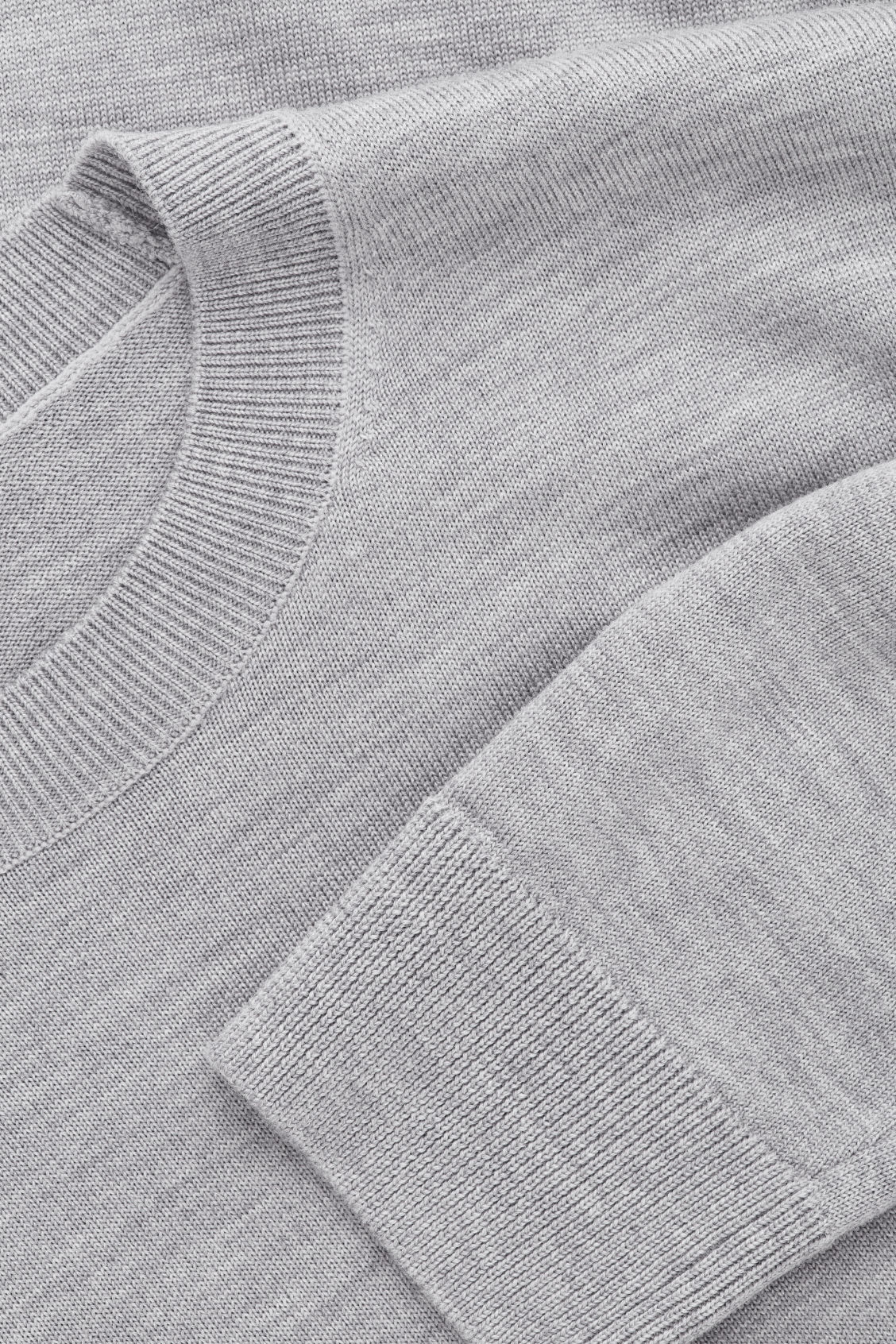 Side image of Cos merino wool jumper in grey