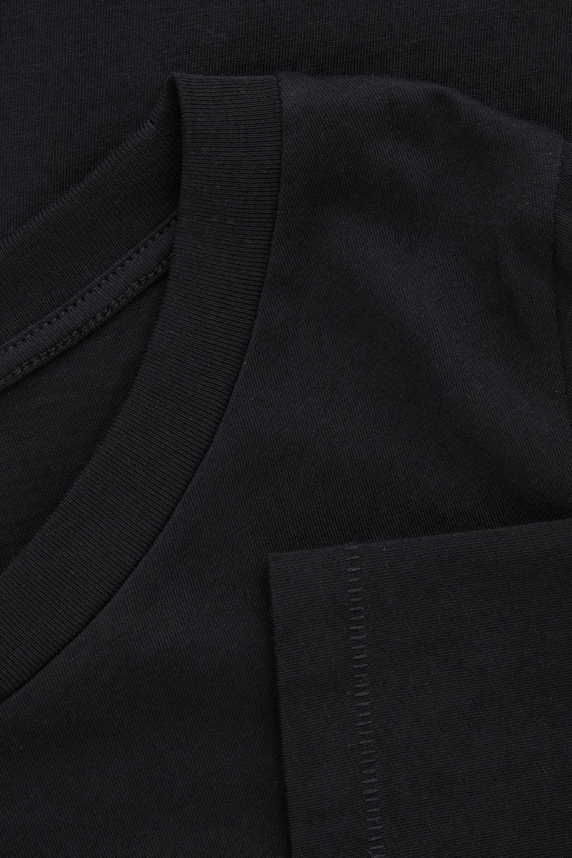 Side image of Cos ¾-sleeved cotton top in black