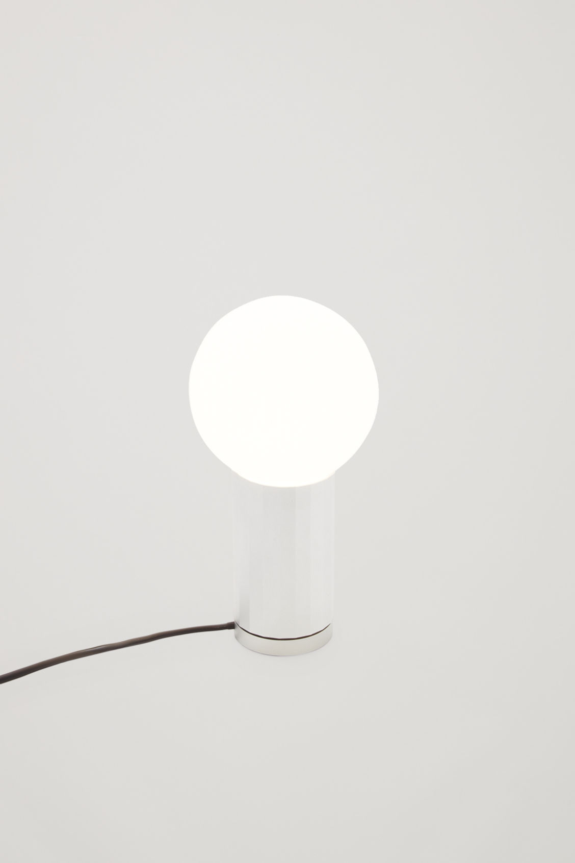Front image of Cos hay turn on lamp in silver