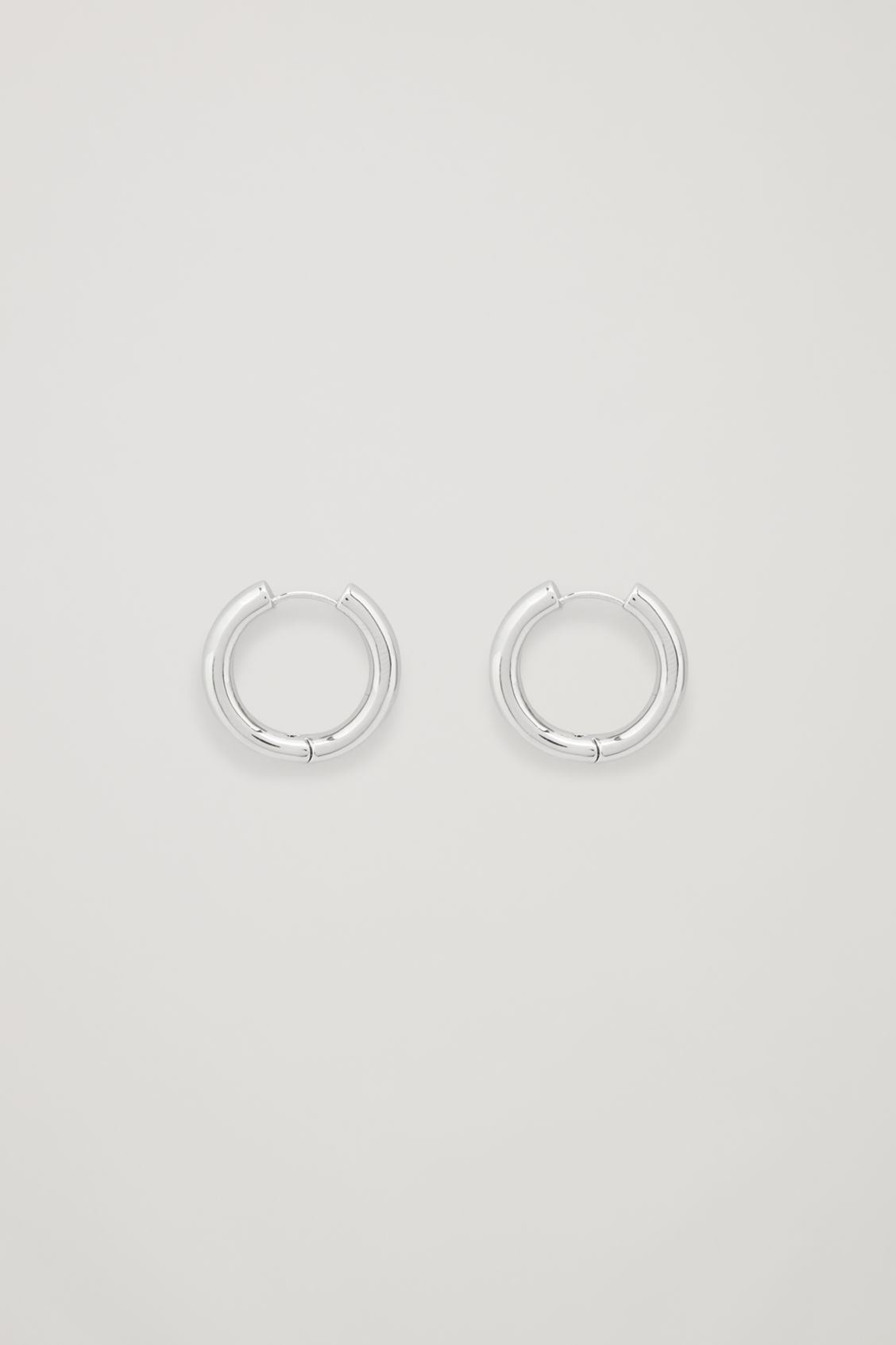 Front image of Cos chunky hoops in silver