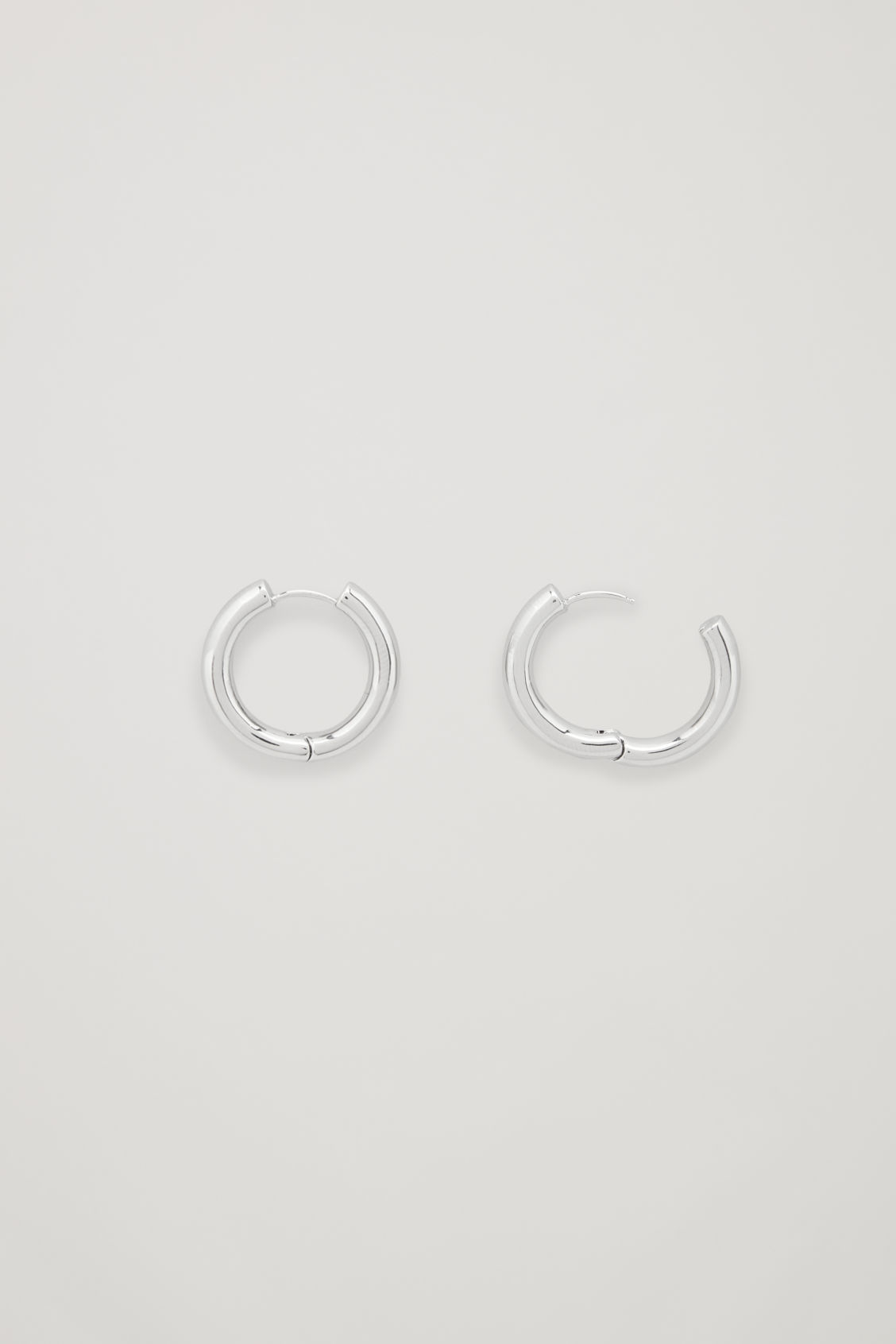 Side image of Cos chunky hoops in silver