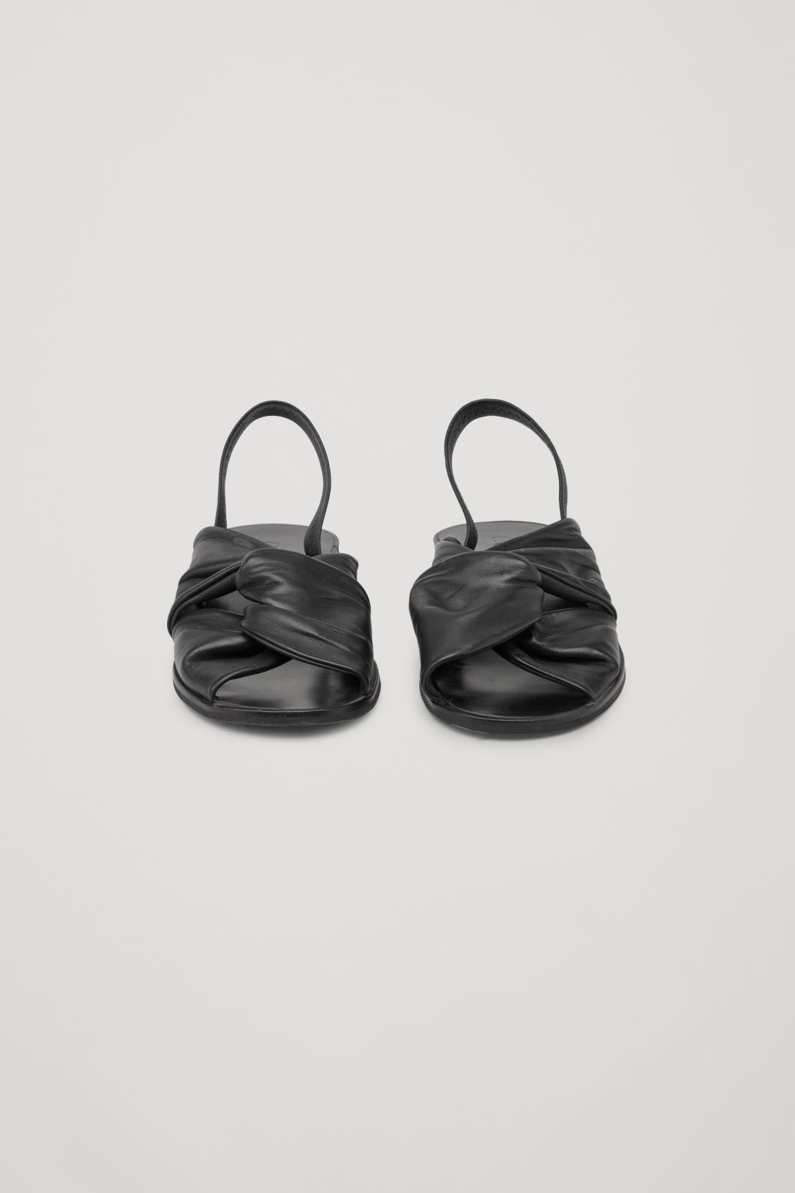 Side image of Cos knotted leather sandals in black
