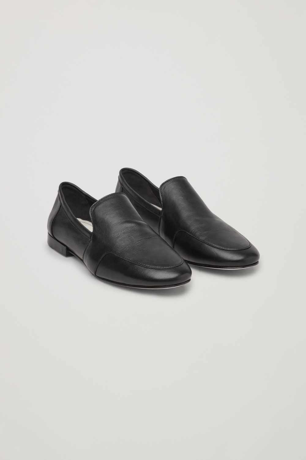 Front image of Cos soft loafers in black