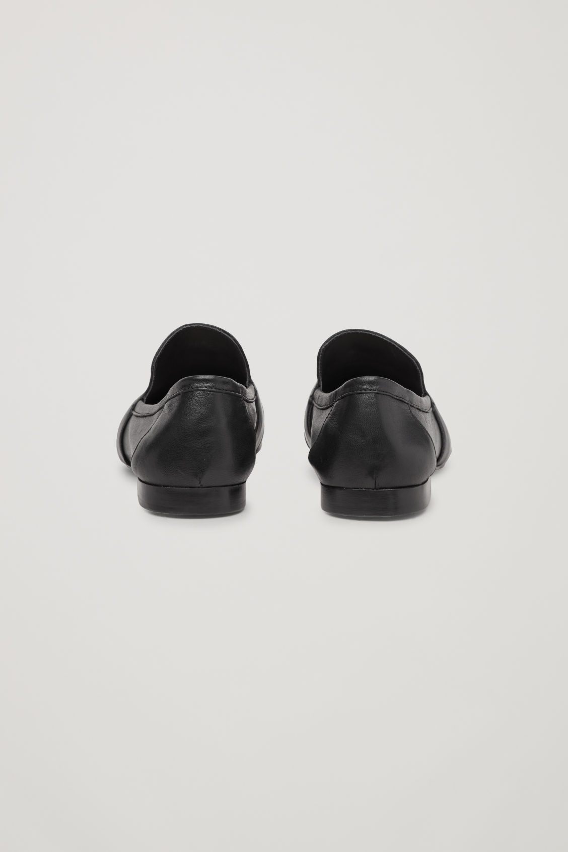 Side image of Cos soft loafers in black