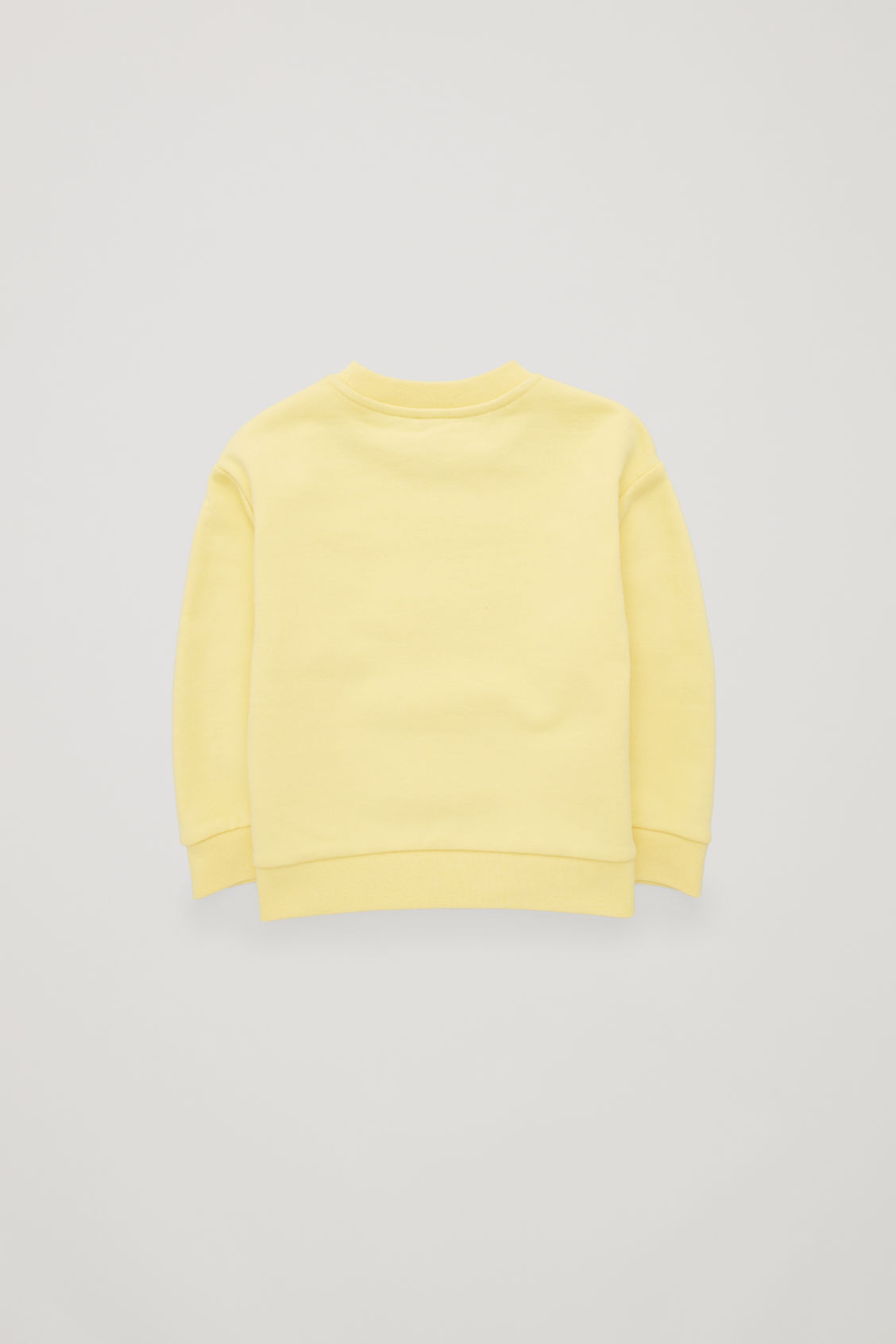 Side image of Cos recycled cotton sweatshirt in yellow
