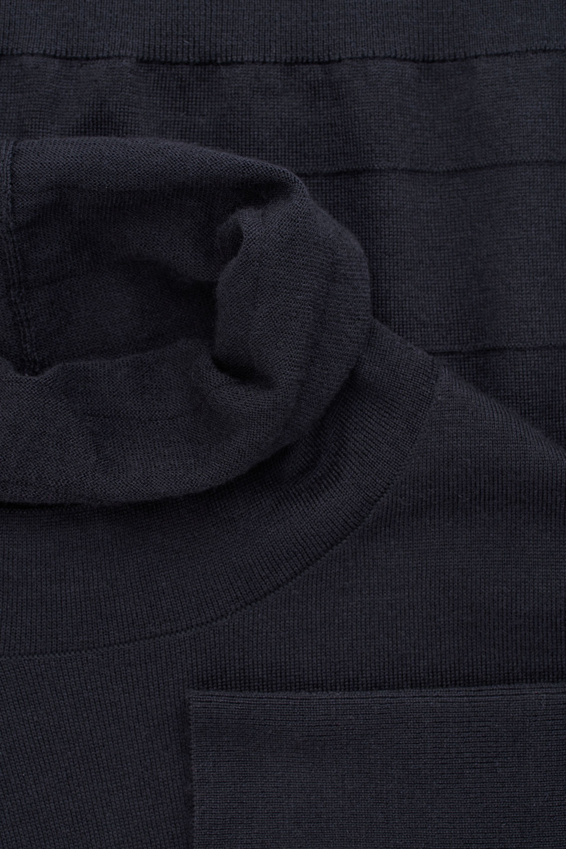 Side image of Cos reverse-stitched wool jumper in blue