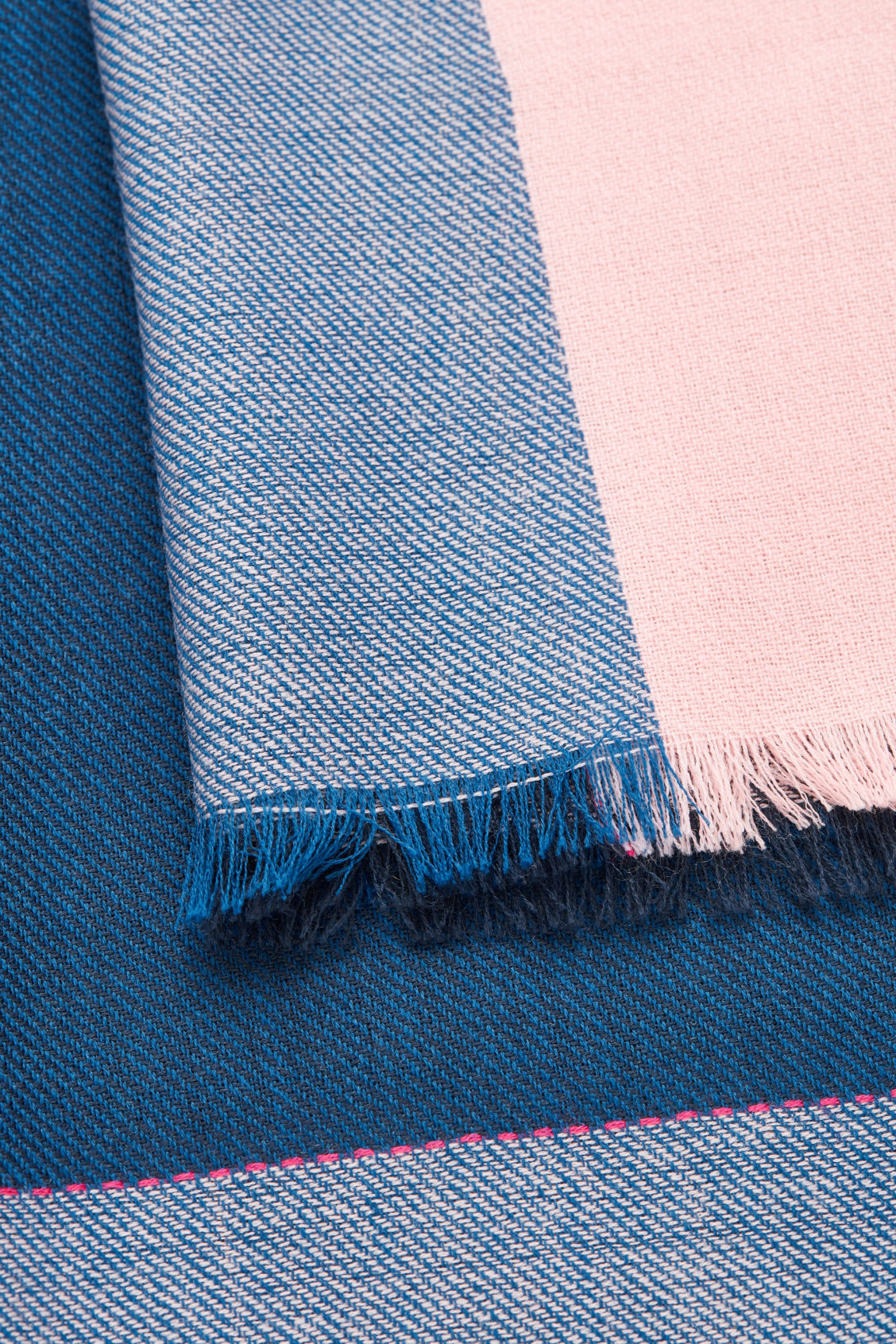 Side image of Cos interwoven checked wool scarf in blue