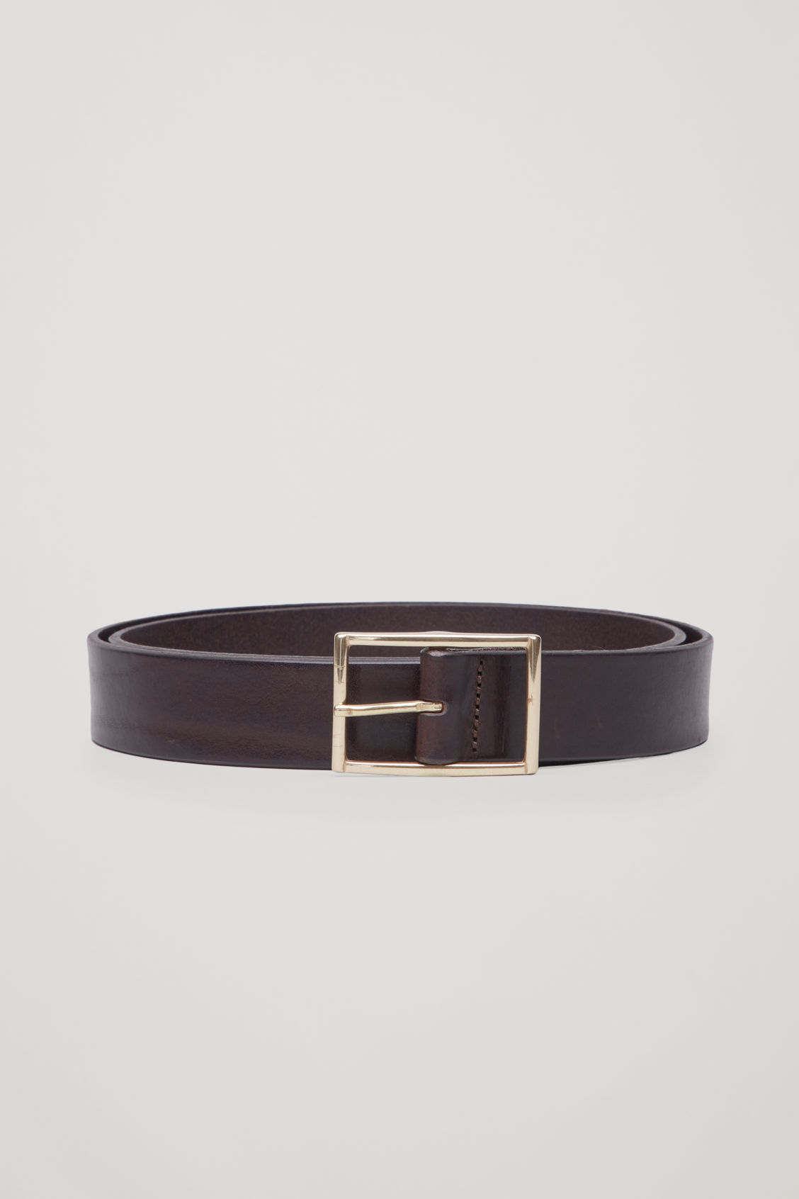 Front image of Cos leather belt with brass buckle in brown