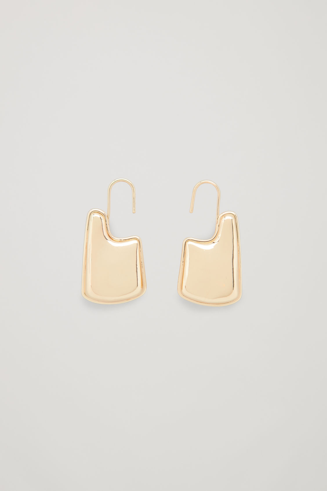 Front image of Cos sculptured drop earrings in gold