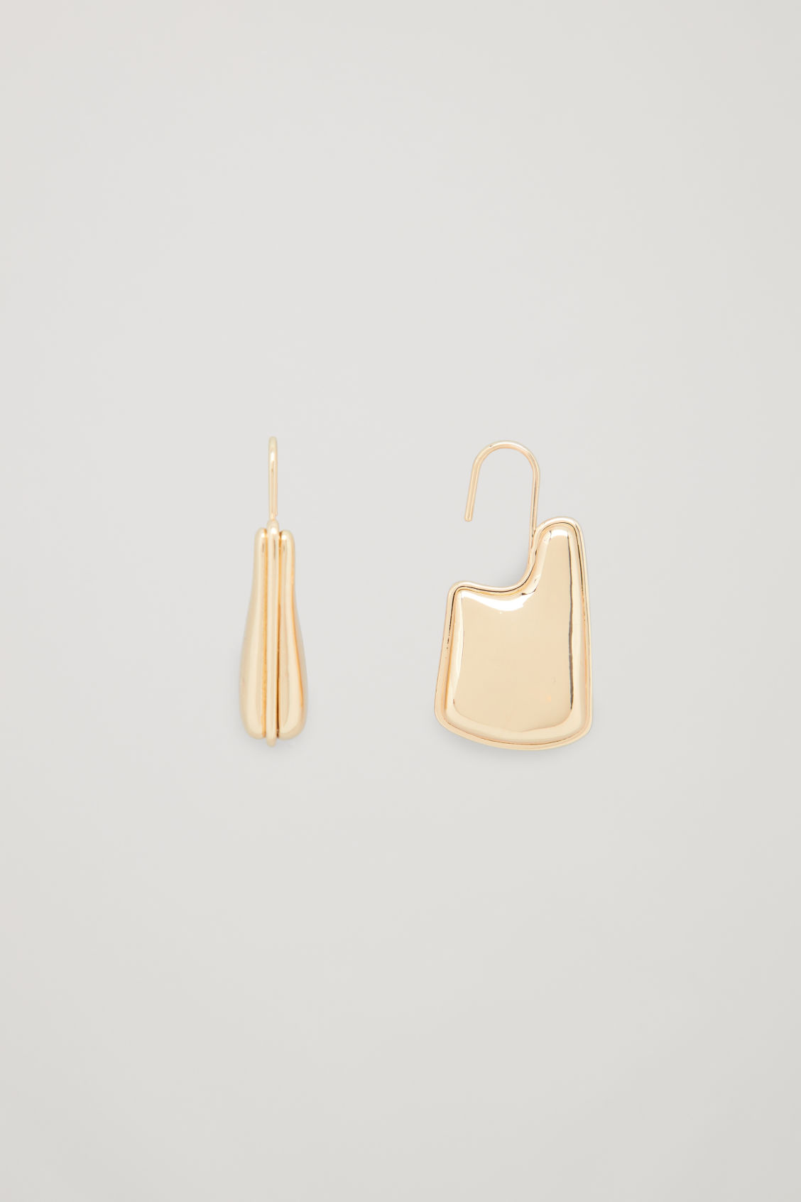 Side image of Cos sculptured drop earrings in gold