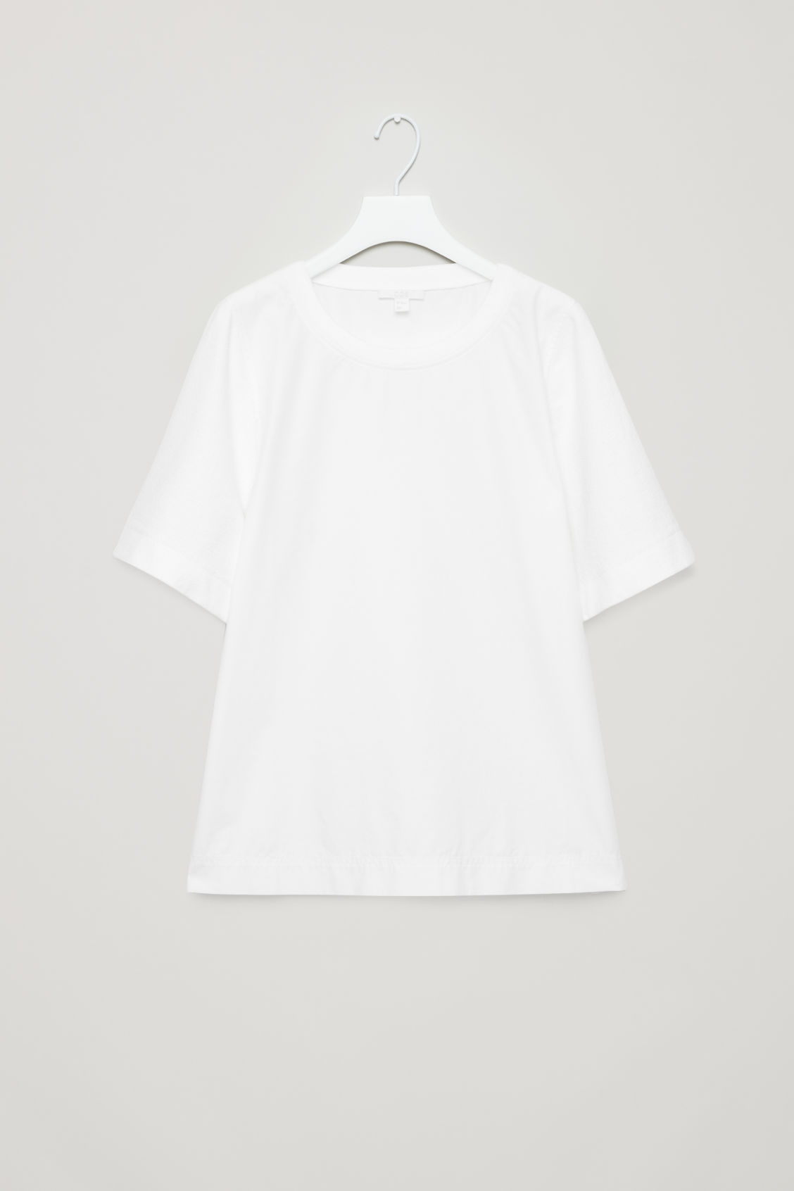 Front image of Cos top with textured sleeves in white