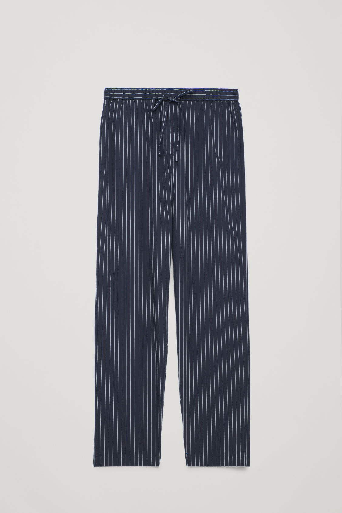 Front image of Cos pinstriped pyjama trousers in blue