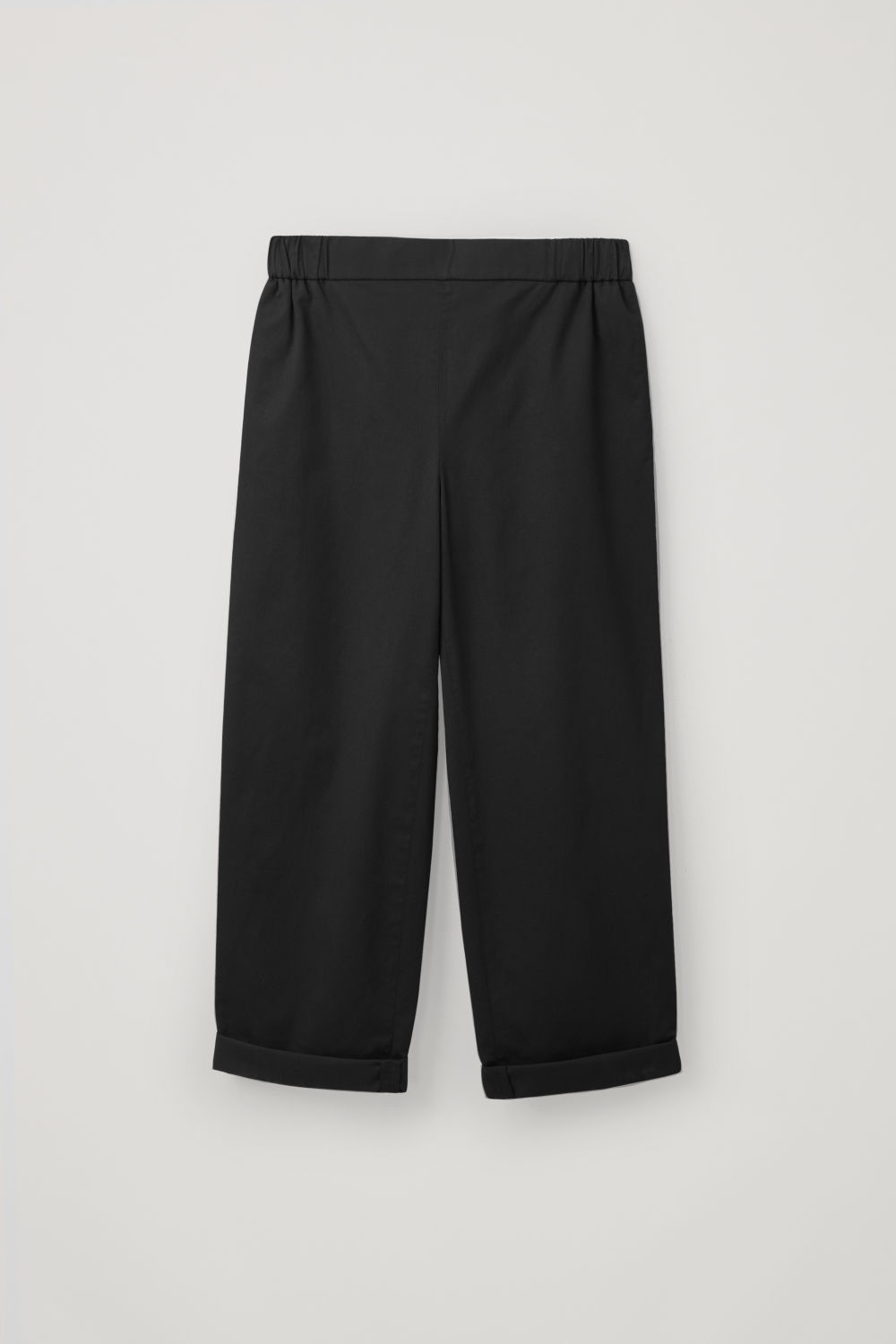 Front image of Cos cropped cotton poplin trousers in black