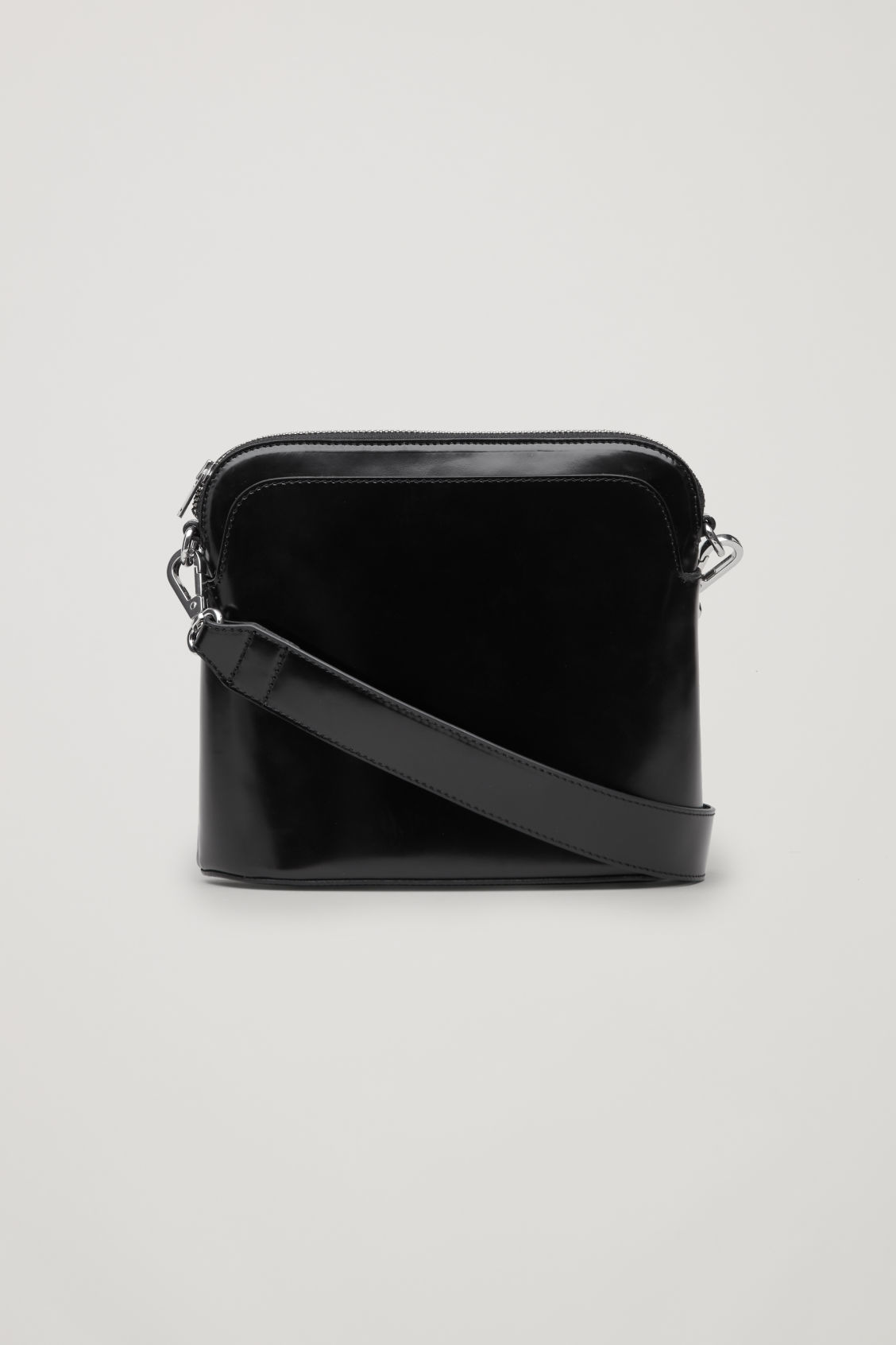 Front image of Cos polished leather crossbody bag in black