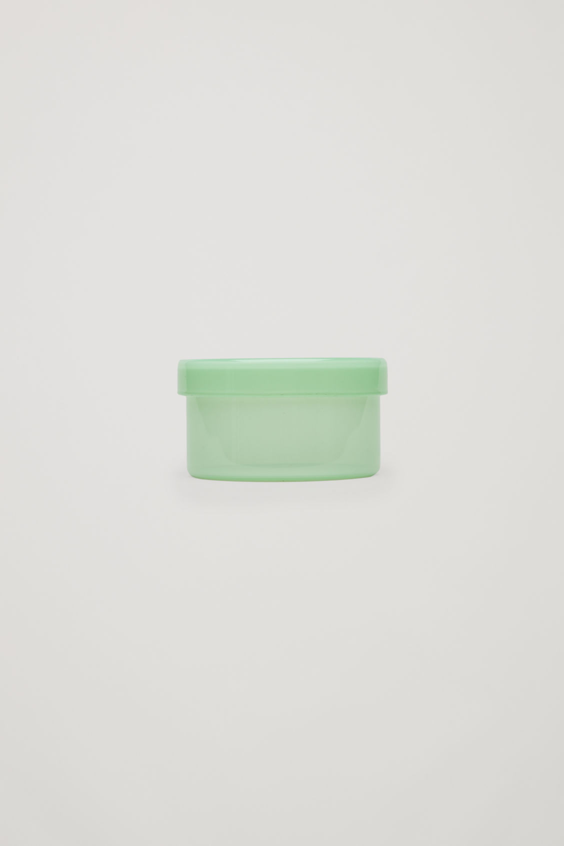 Front image of Cos hay medium container in green