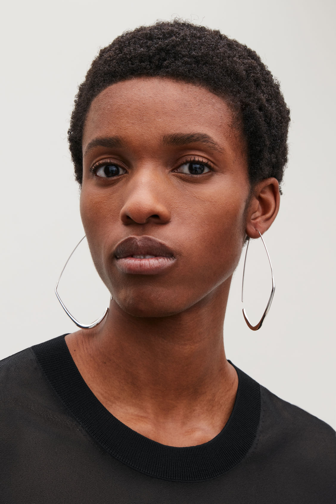 Side image of Cos gradual hoop earrings in silver