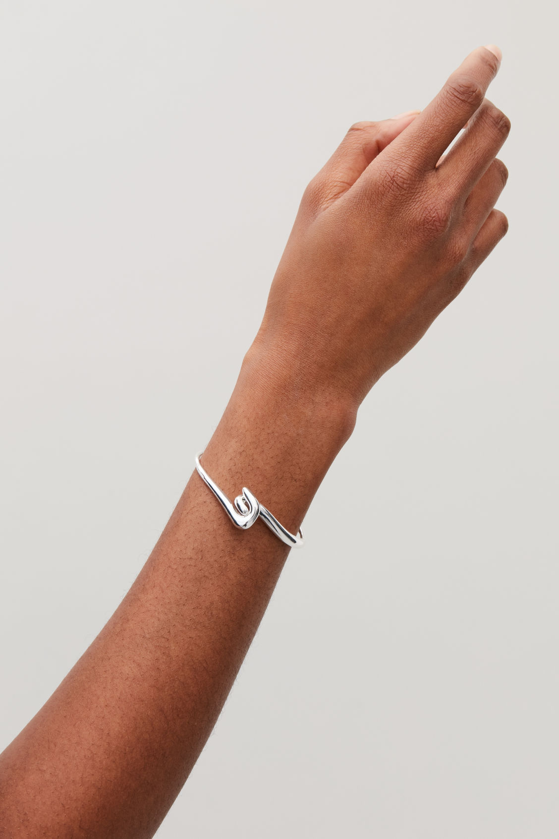 Side image of Cos hook closure bracelet in silver