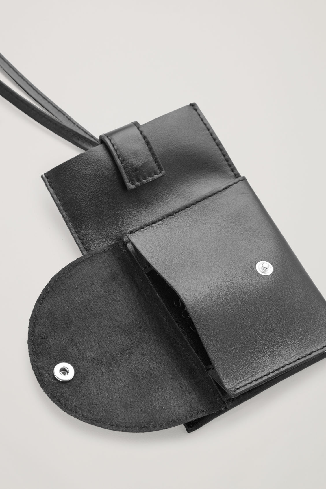 Side image of Cos leather phone case with purse in black