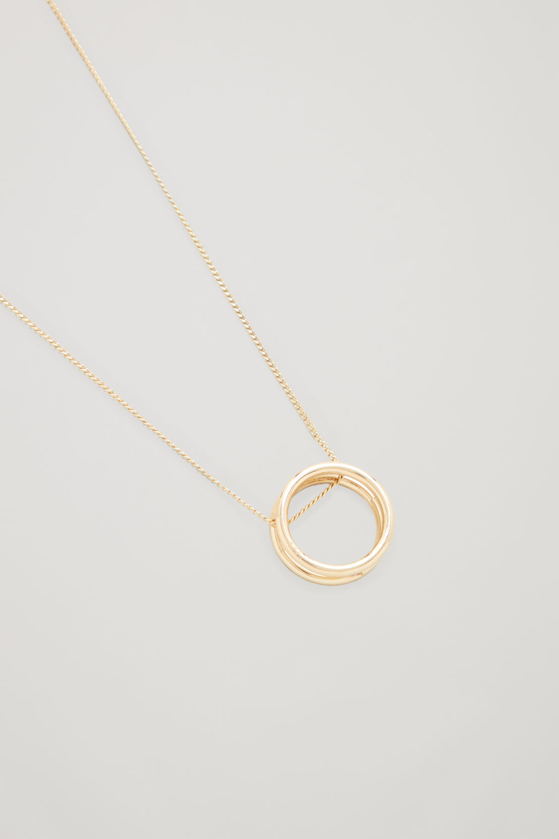 Side image of Cos layered-hoop pendant necklace in gold