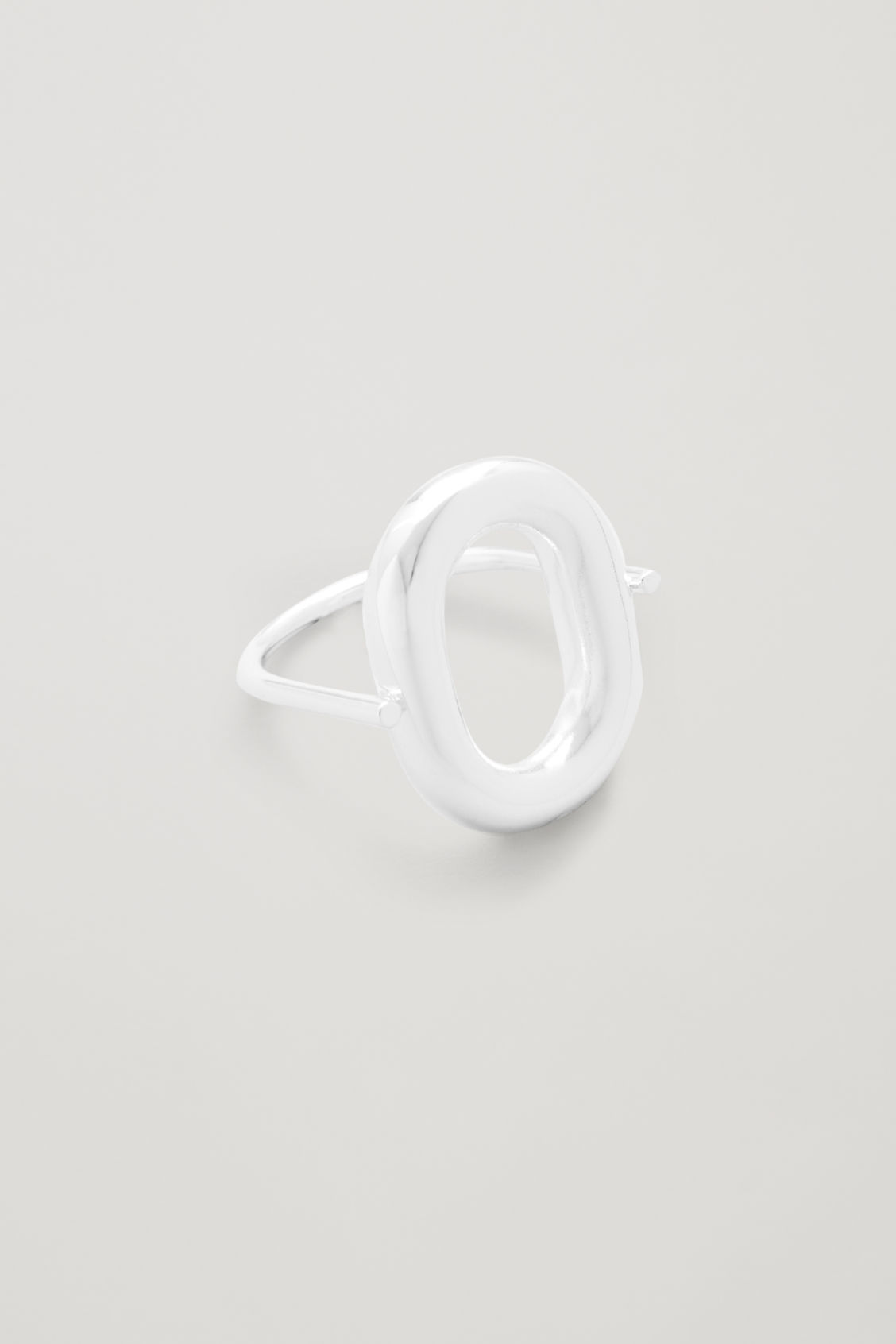 Side image of Cos rotating oval ring in silver